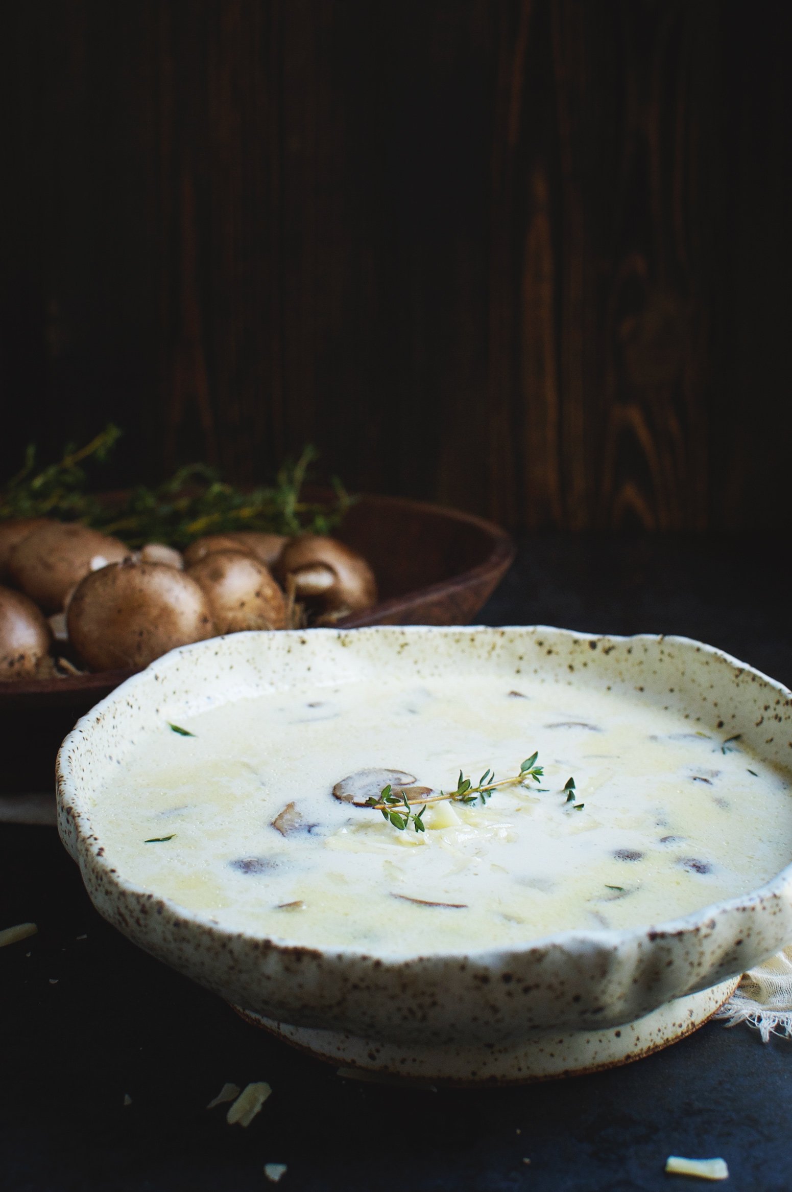 Low-Carb Cheese Soup with Mushrooms and Thyme in a bowl