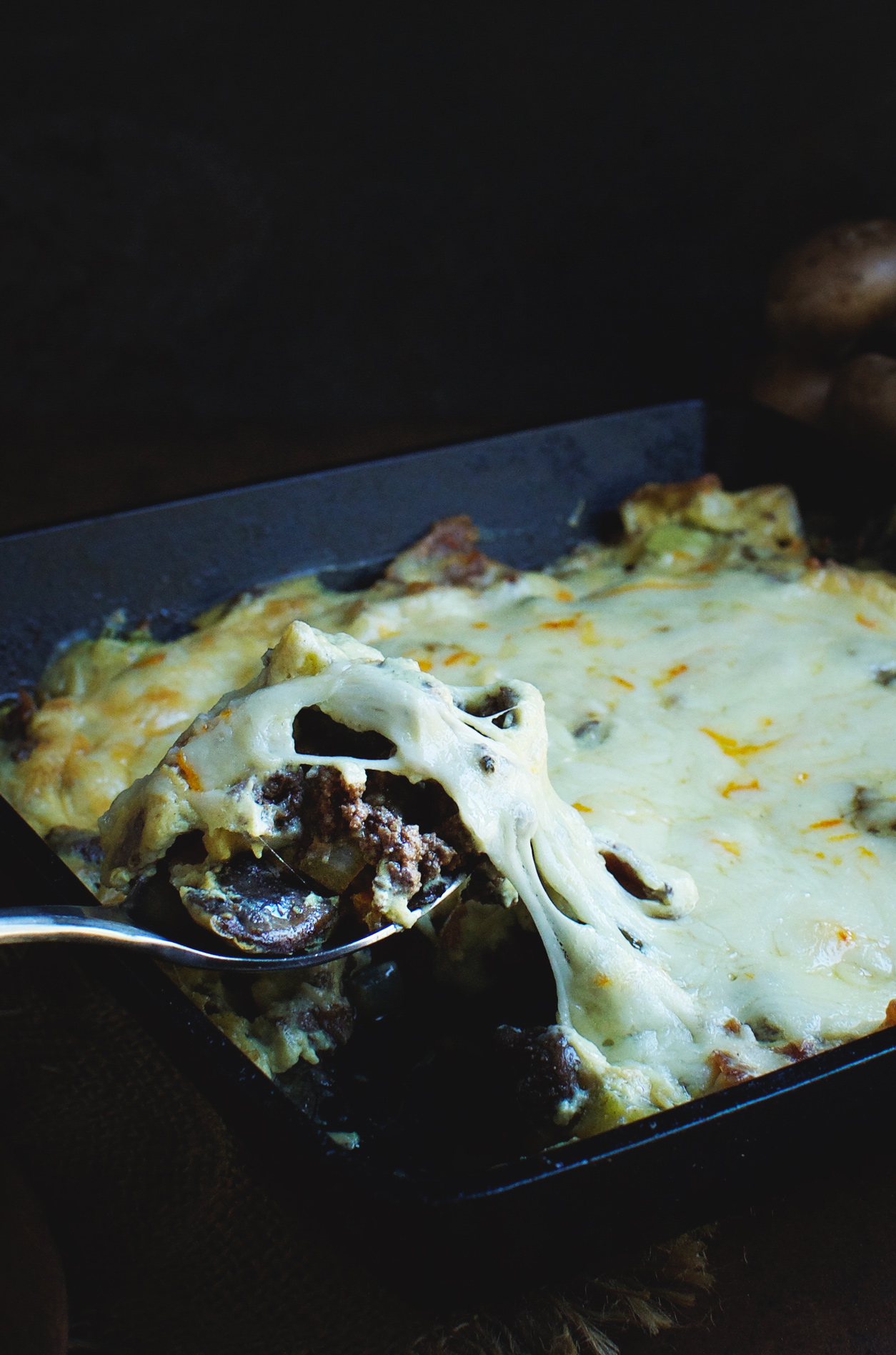 Serving the Ultimate Bacon Cheeseburger Casserole.