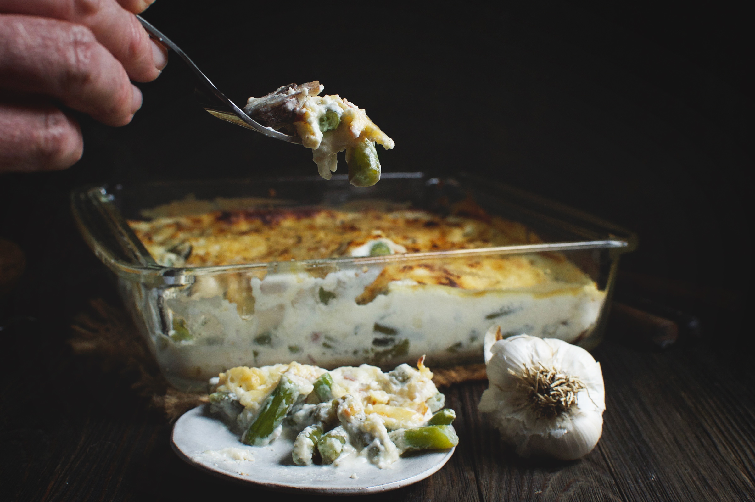 Low-Carb Green Bean and Mushroom Casserole being spooned out of the baking dish.
