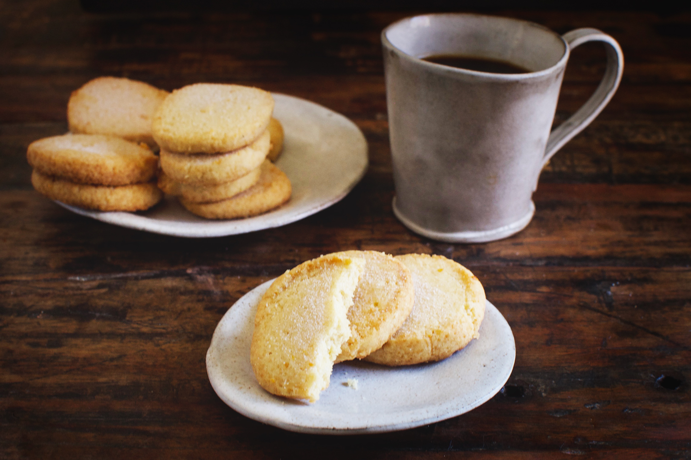 Low-Carb Sugar Cookies on a plate. One has bite taken out.