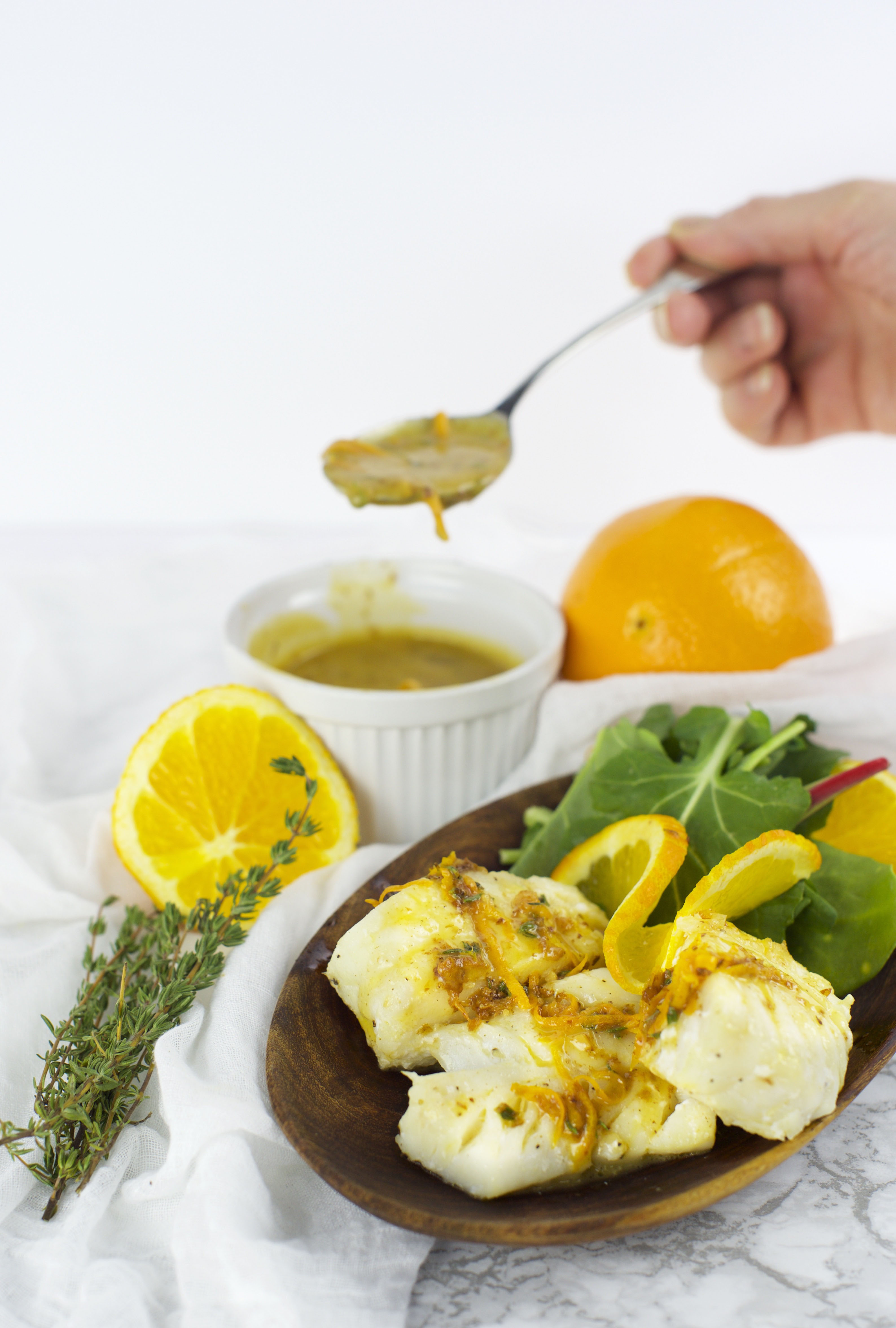 Photo of Haddock with Orange Thyme Sauce with spoon