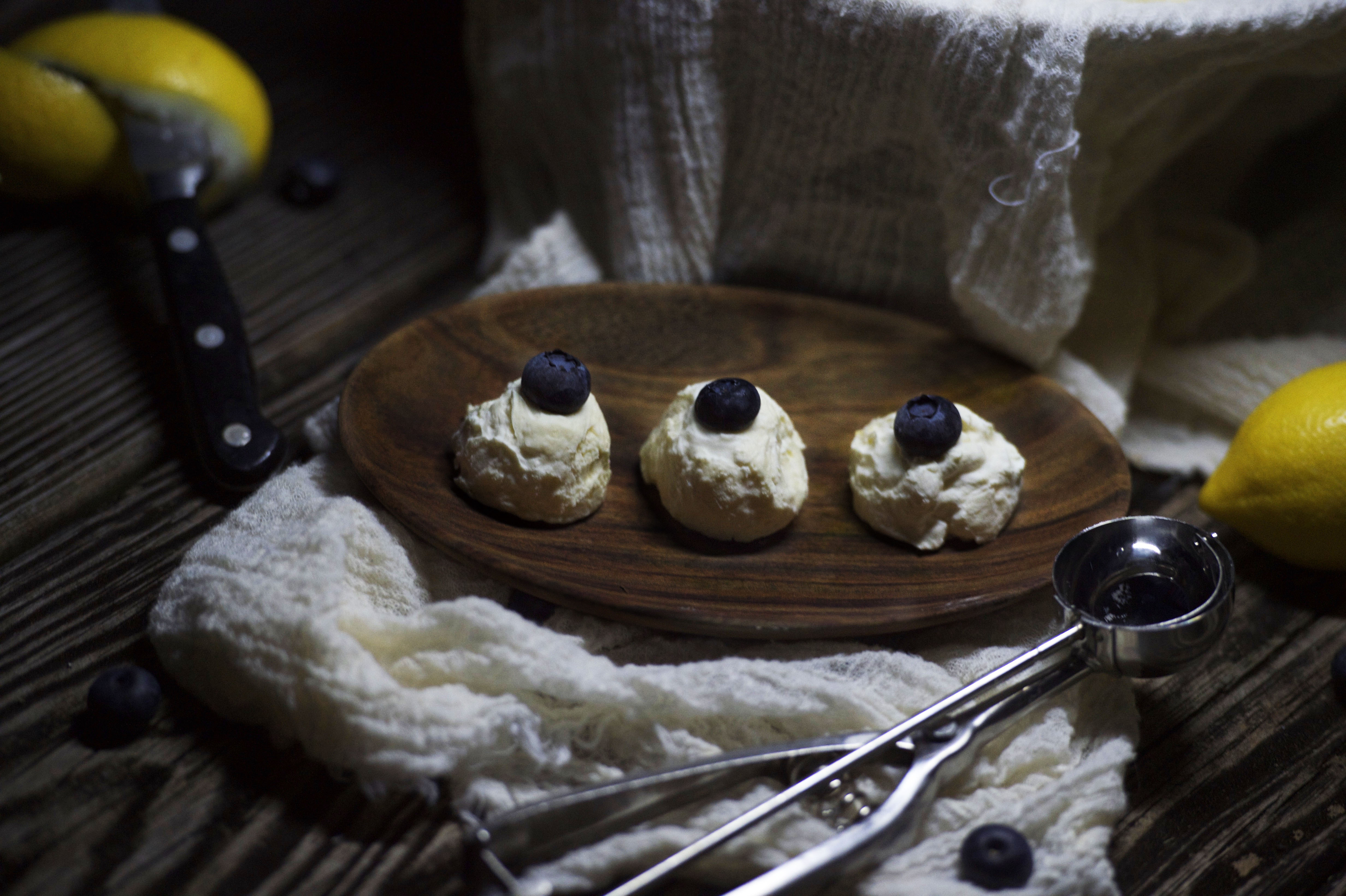 Photo of Low Carb Lemon Blueberry Truffles on a plate.