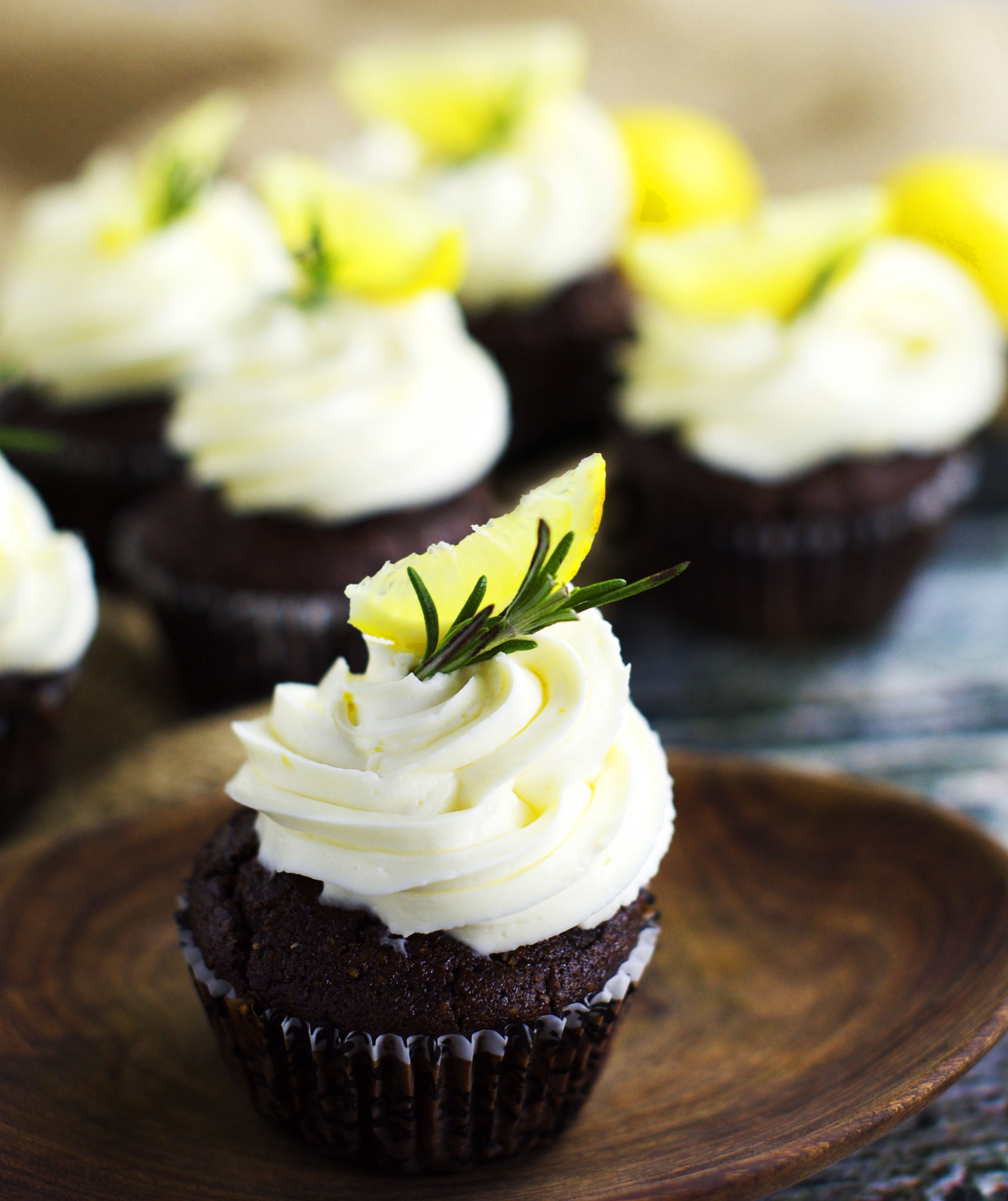 Close up Photo of Low-Carb Chocolate Rosemary Cupcakes with Lemon Frosting