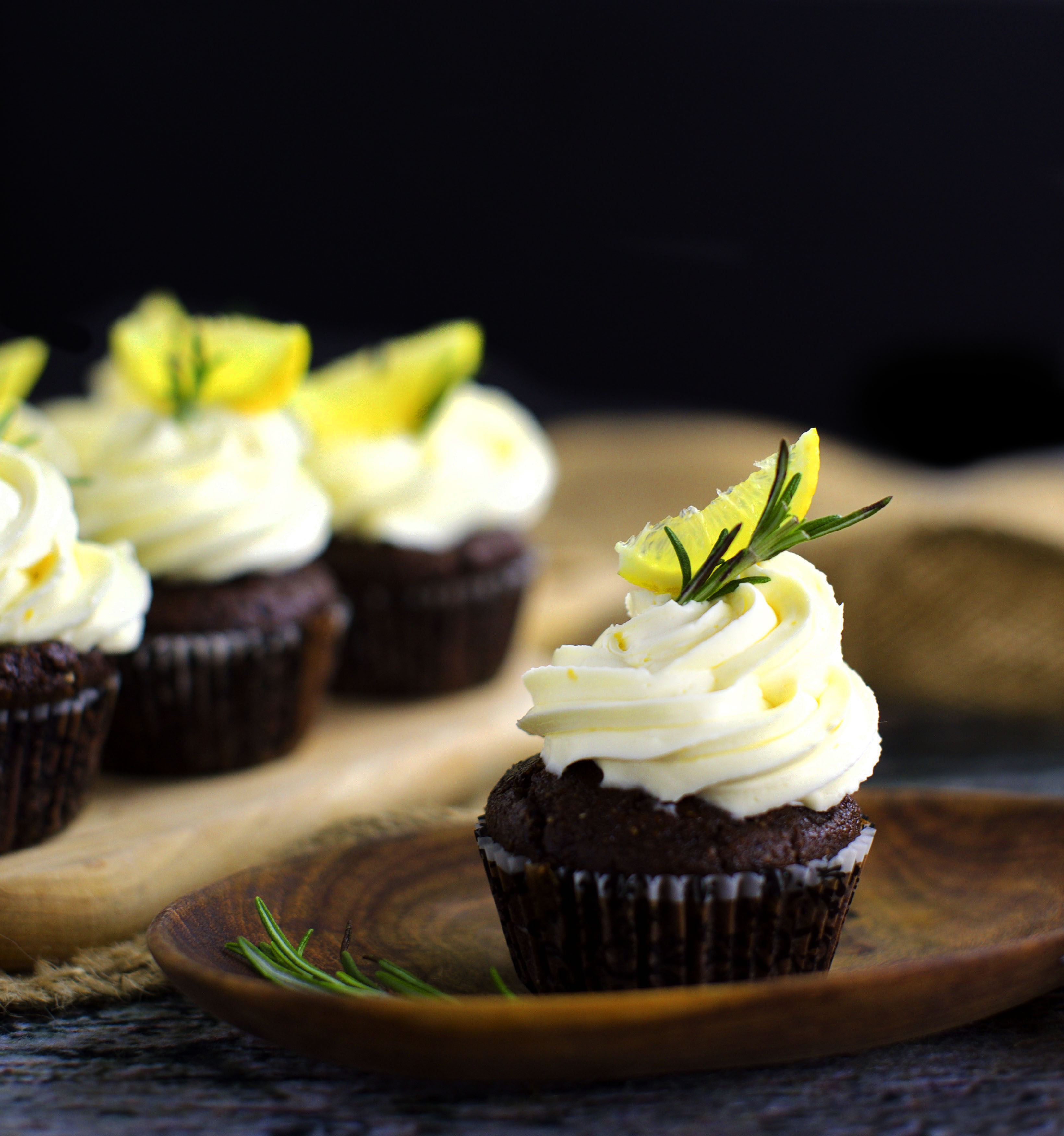 Photo of Low-Carb Chocolate Rosemary Cupcakes with Lemon Frosting on a plate