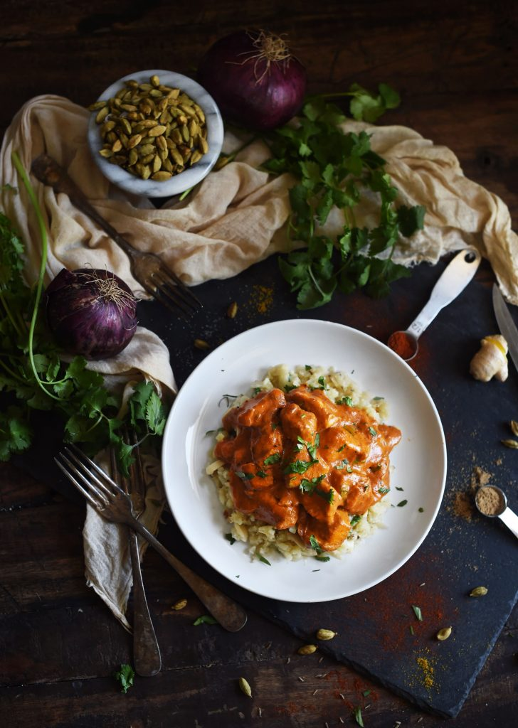 Low-Carb chicken tikka masala on white plate with herbs