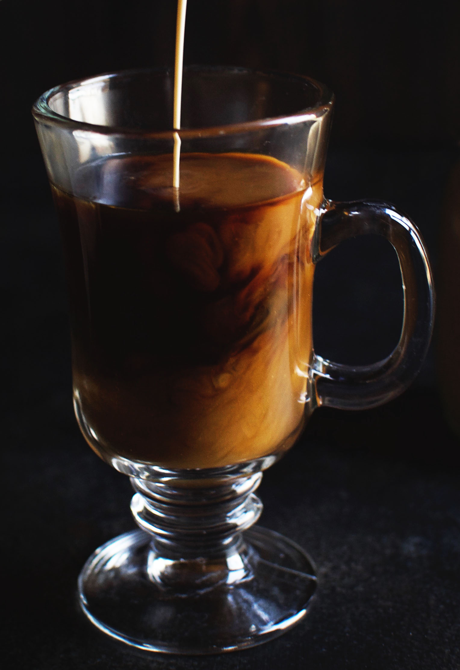 Pouring Low-Carb Irish cream into some coffee.