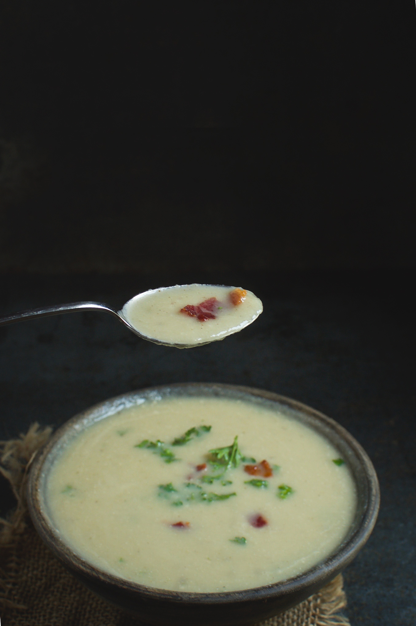 "This Low-Carb ""Potato"" Leek Soup is a Paleo, low-carb, and dairy-free comfort food. No one will know this soup is made with cauliflower and not potatoes."