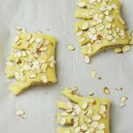 Bear claws with egg wash and almonds sprinkled on top