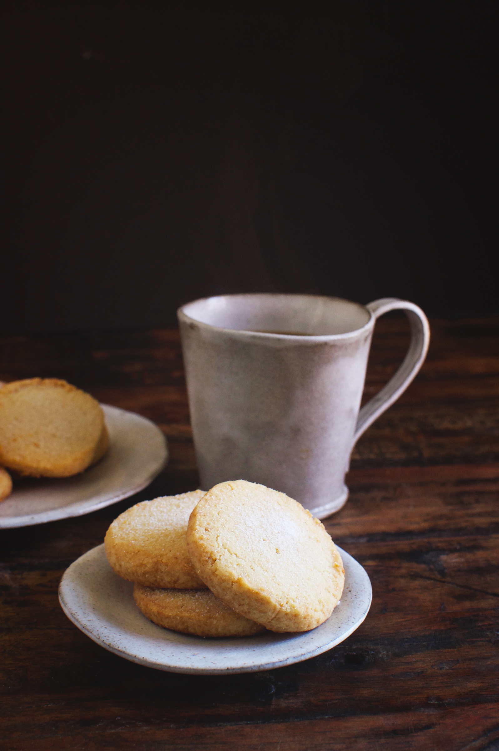 Low-Carb Sugar Cookies on a plate with a cup of coffee