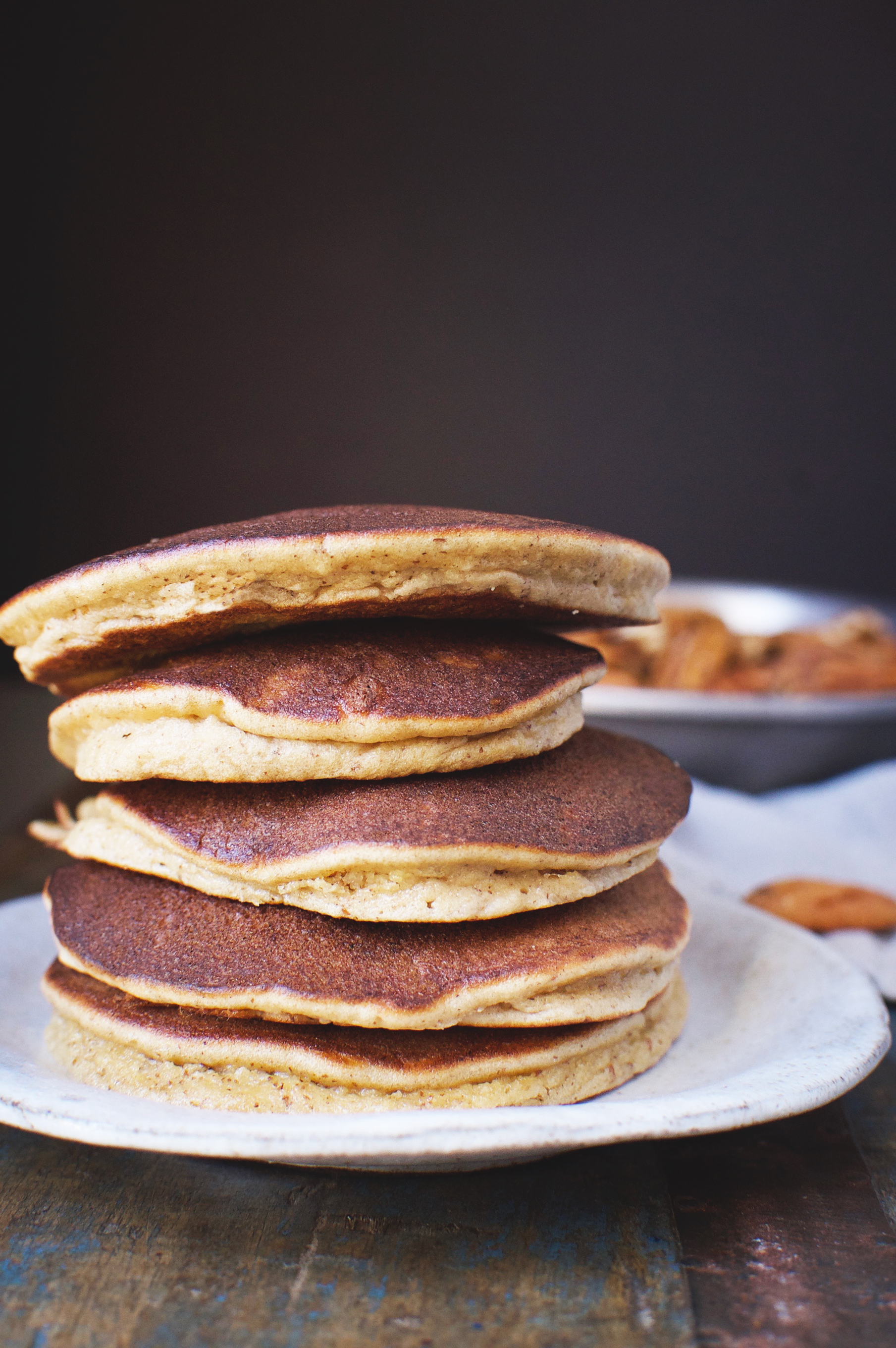 Low-Carb Banana Nut Pancakes stacked on a plate.