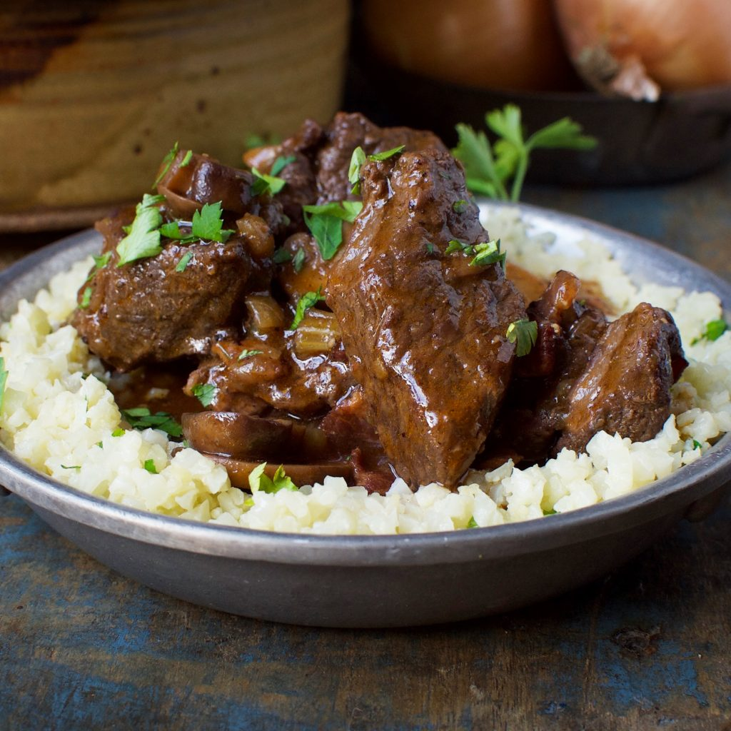 Low-Carb Beef Bourguignon Stew served over riced cauliflower.