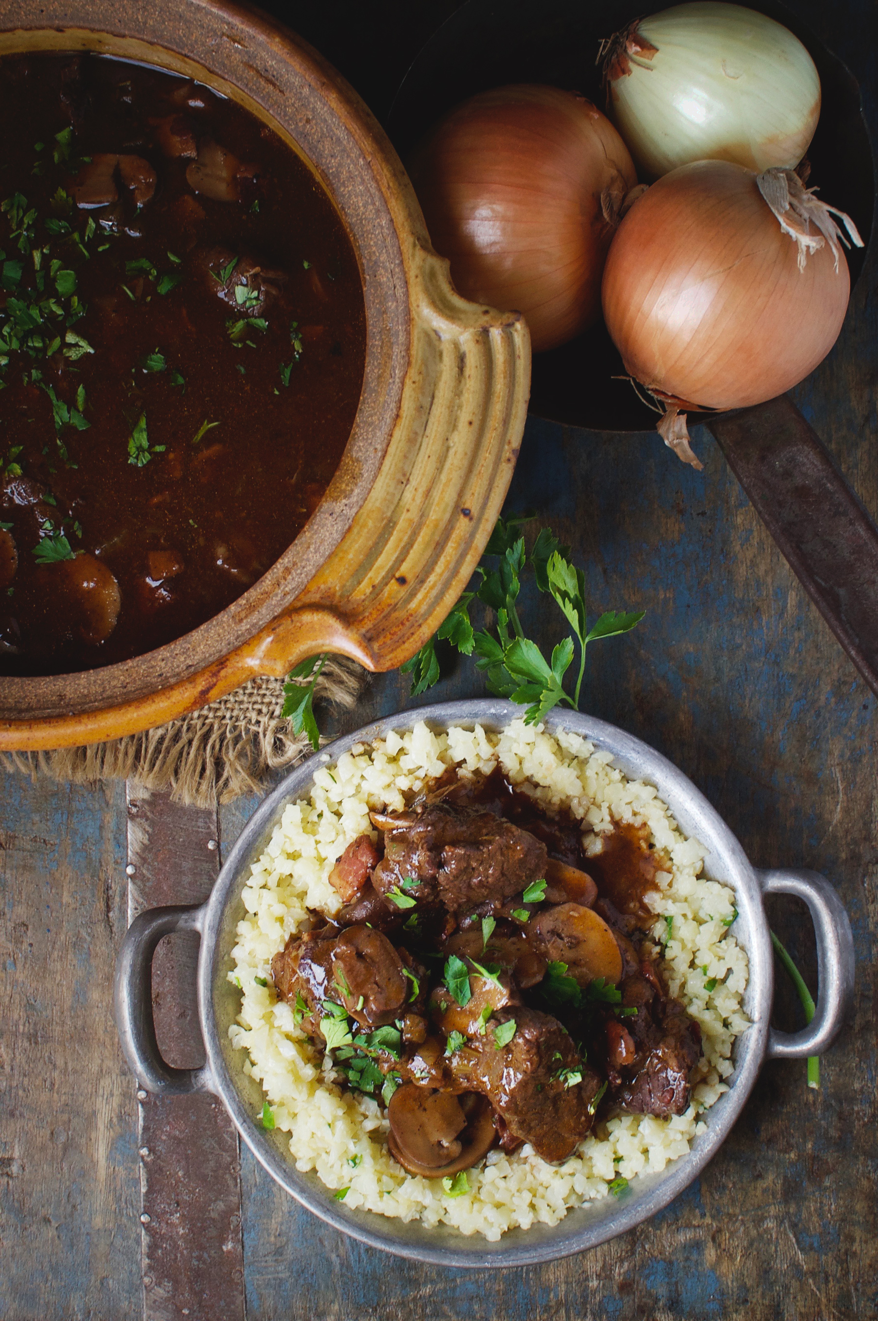 Low-Carb Beef Bourguignon Stew showing some in a serving bowl and some served over cauliflower rice.