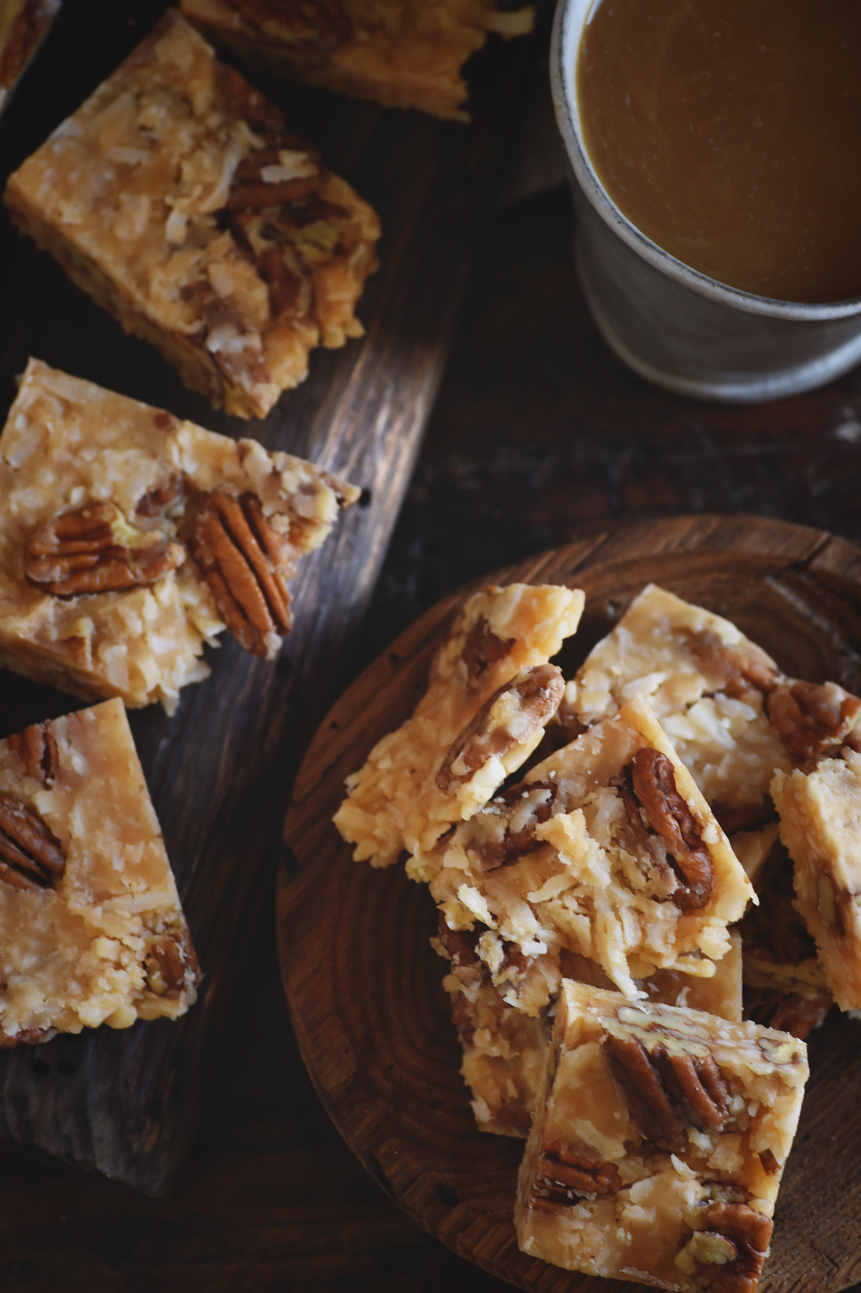 Low-Carb Coconut Pecan Snack Bar Recipe--some on a plate and some on a cutting board.
