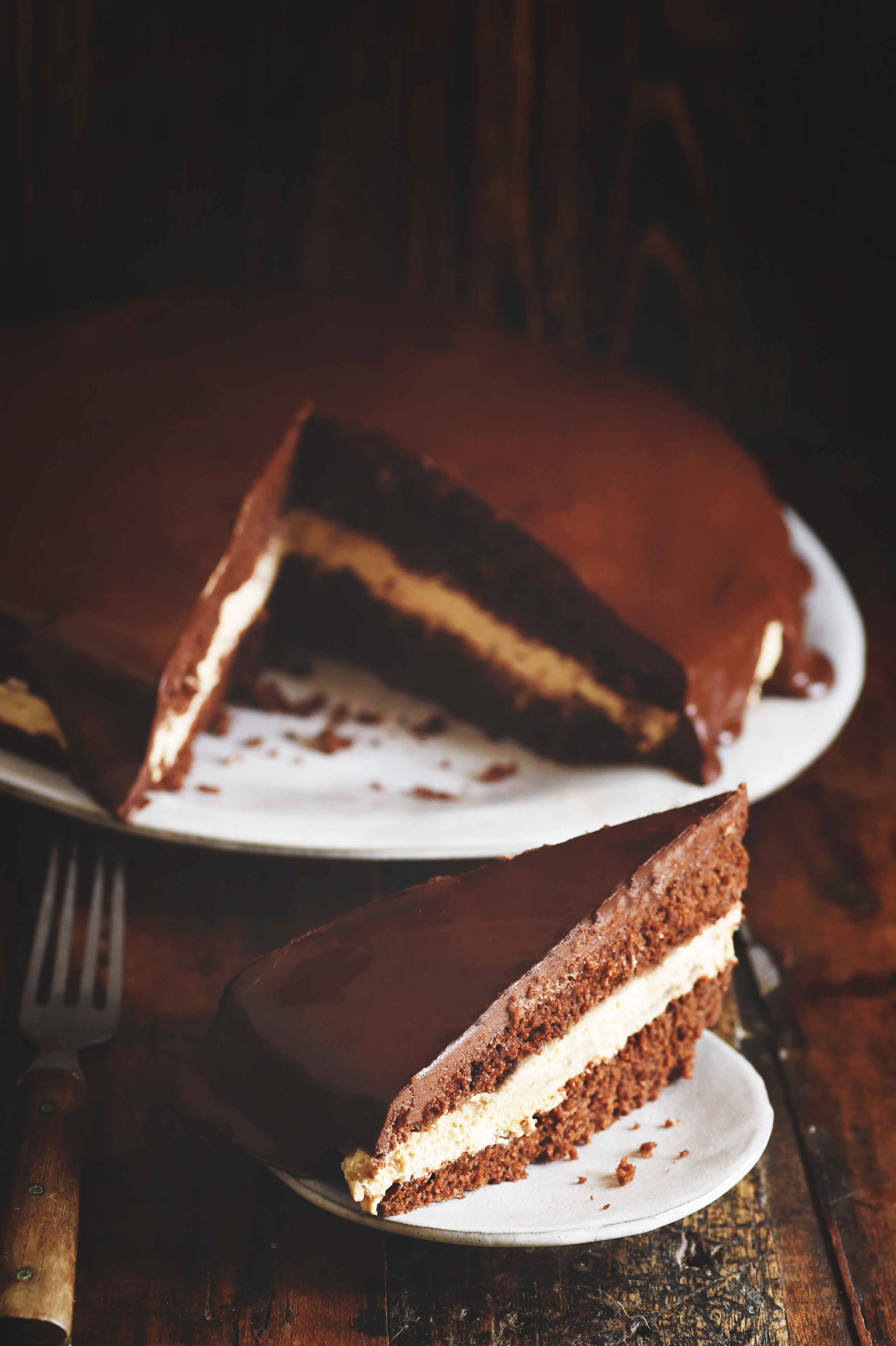Low-Carb Chocolate Latte Dream Cake one piece on a plate with the cake behind.