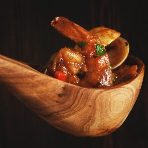 Cioppino Seafood Stew in a wooden spoon