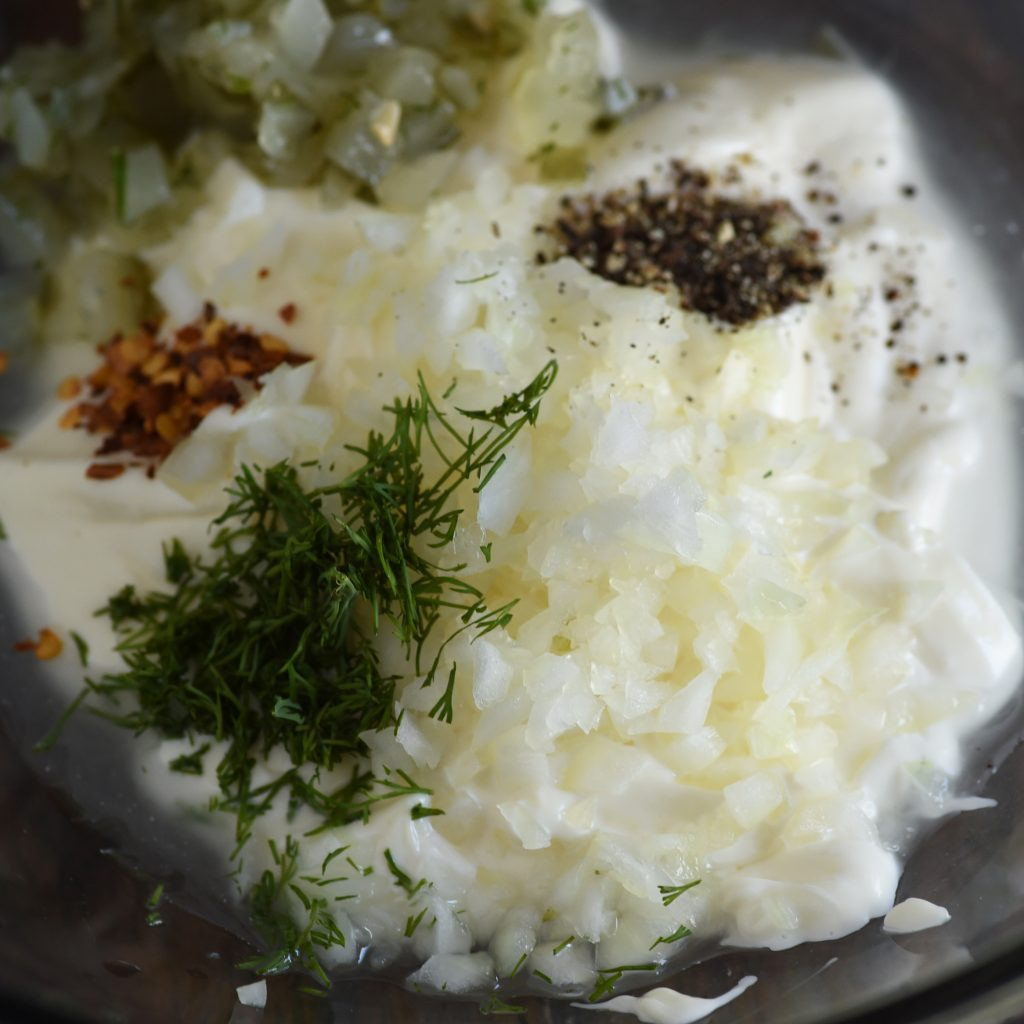 Ingredients for Homemade Tartar Sauce in a mixing bowl