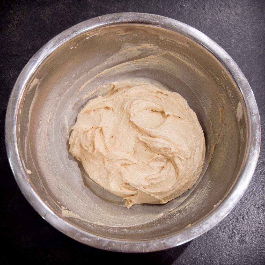 Process photo of completed peanut butter filling in a bowl.