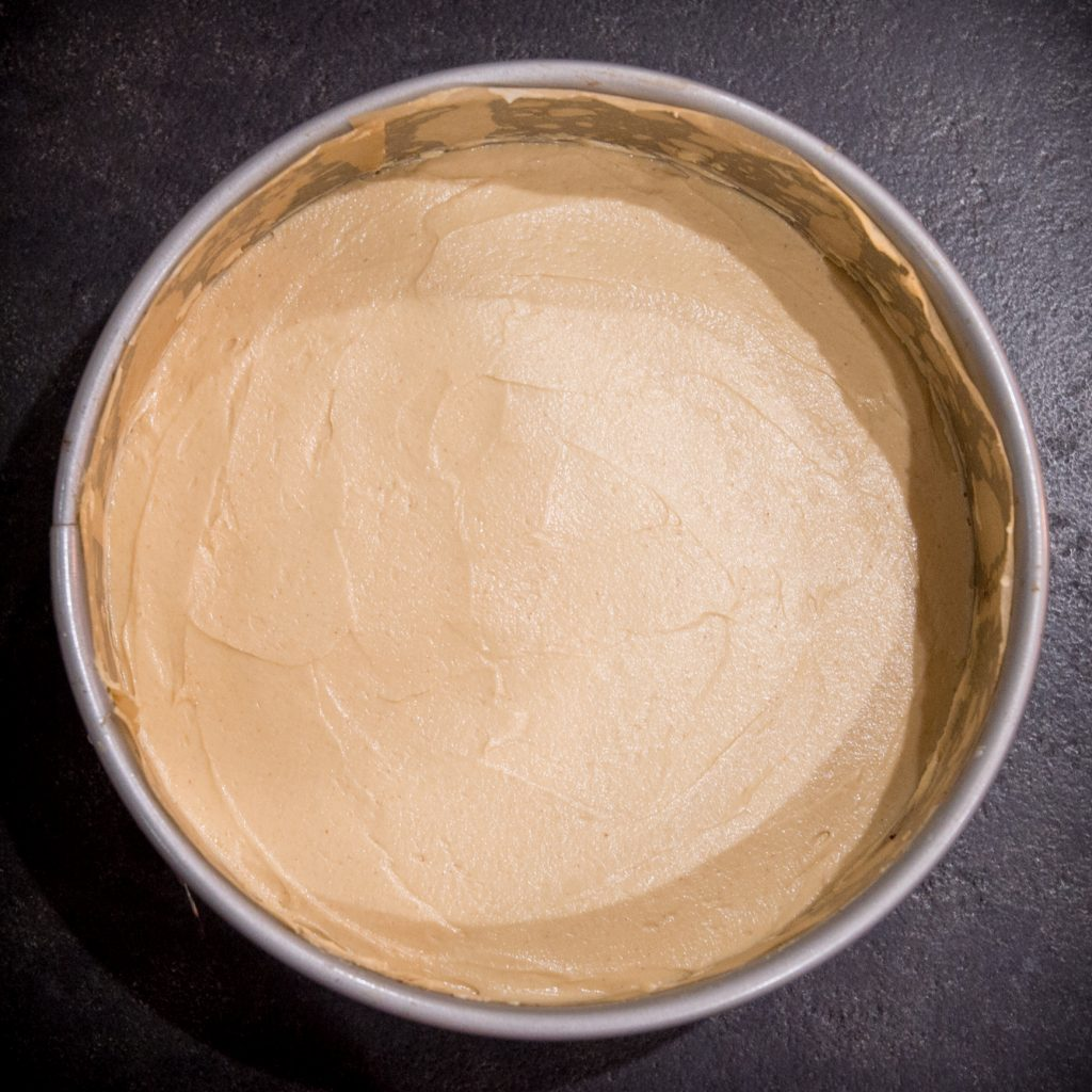 Process photo of peanut butter pie with peanut butter filling added.