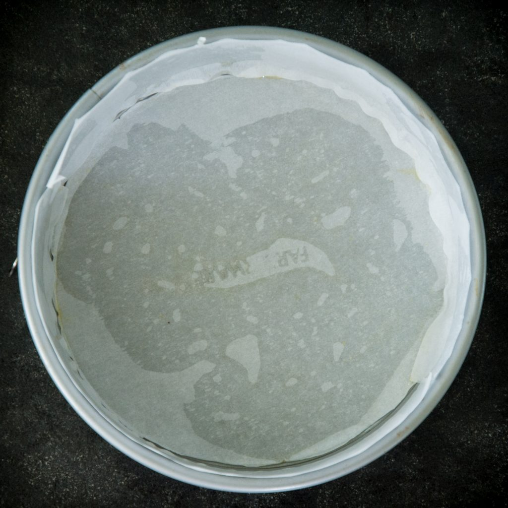 Process photo of lined cake pan.