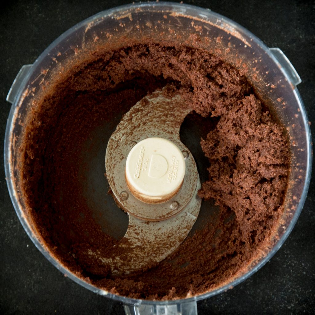 Process photo of pie dough in a food processor.