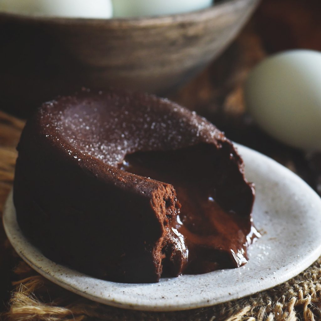 Low-Carb Chocolate Lava Cake served with chocolate center running out.