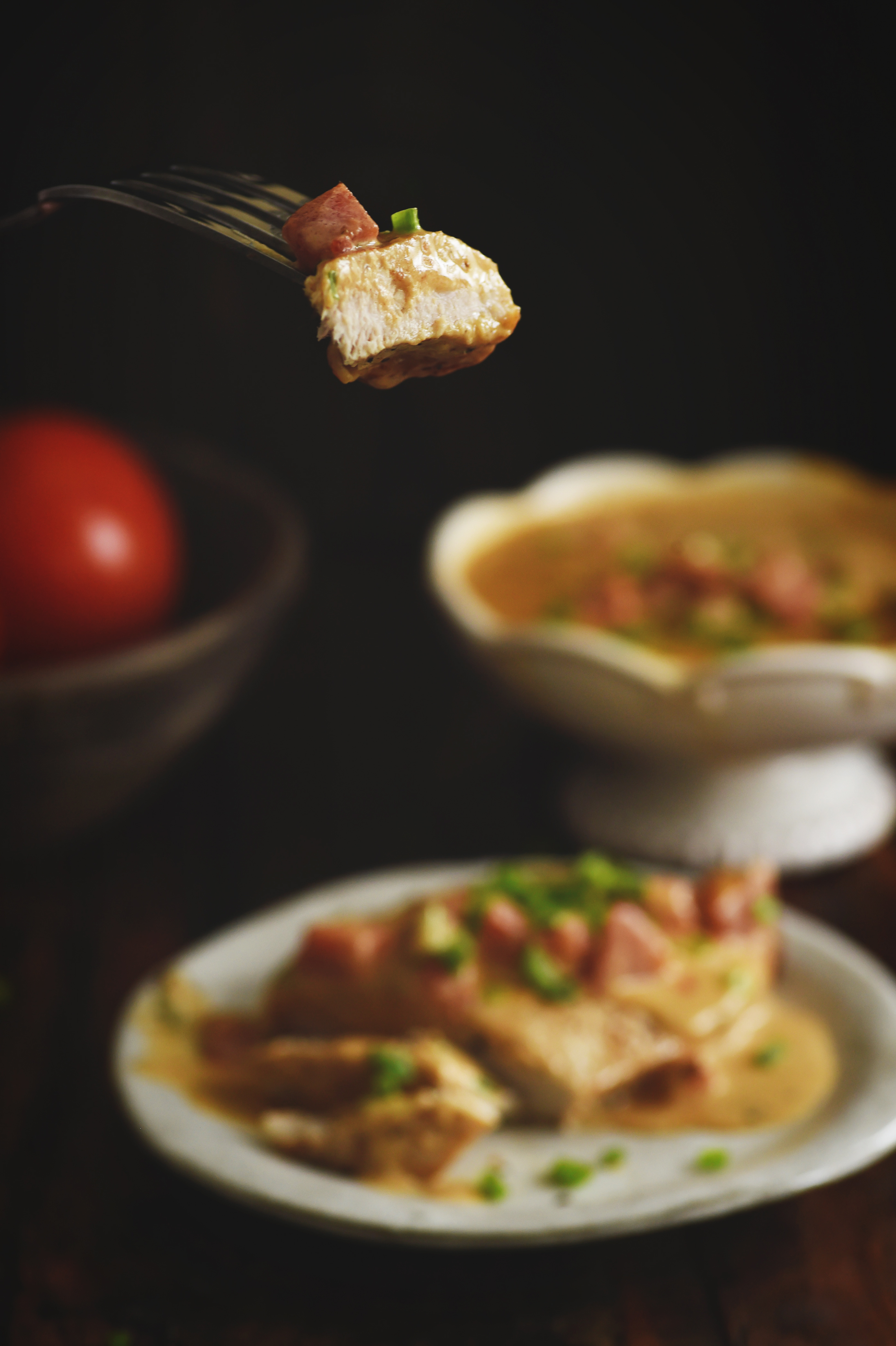 Boneless Pork Chops with Tomato Cream Sauce-Chop cut and a piece on a fork.
