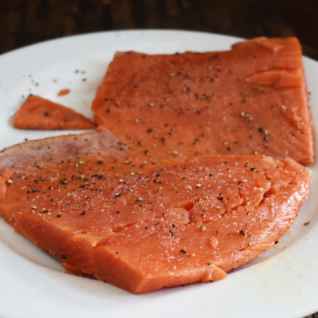 Low-Carb Salmon with Starfruit Salsa-salmon with salt and pepper.