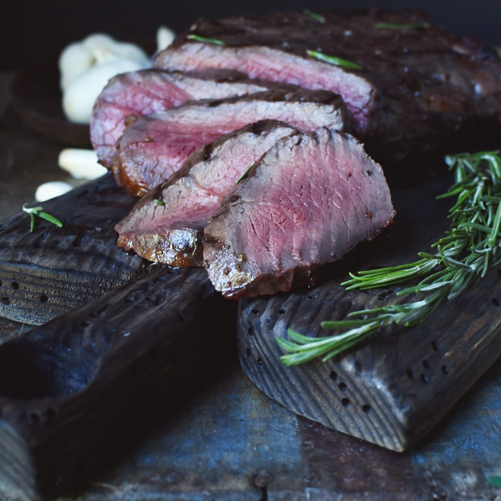 Grilled Marinated London Broil-slices on a cutting board