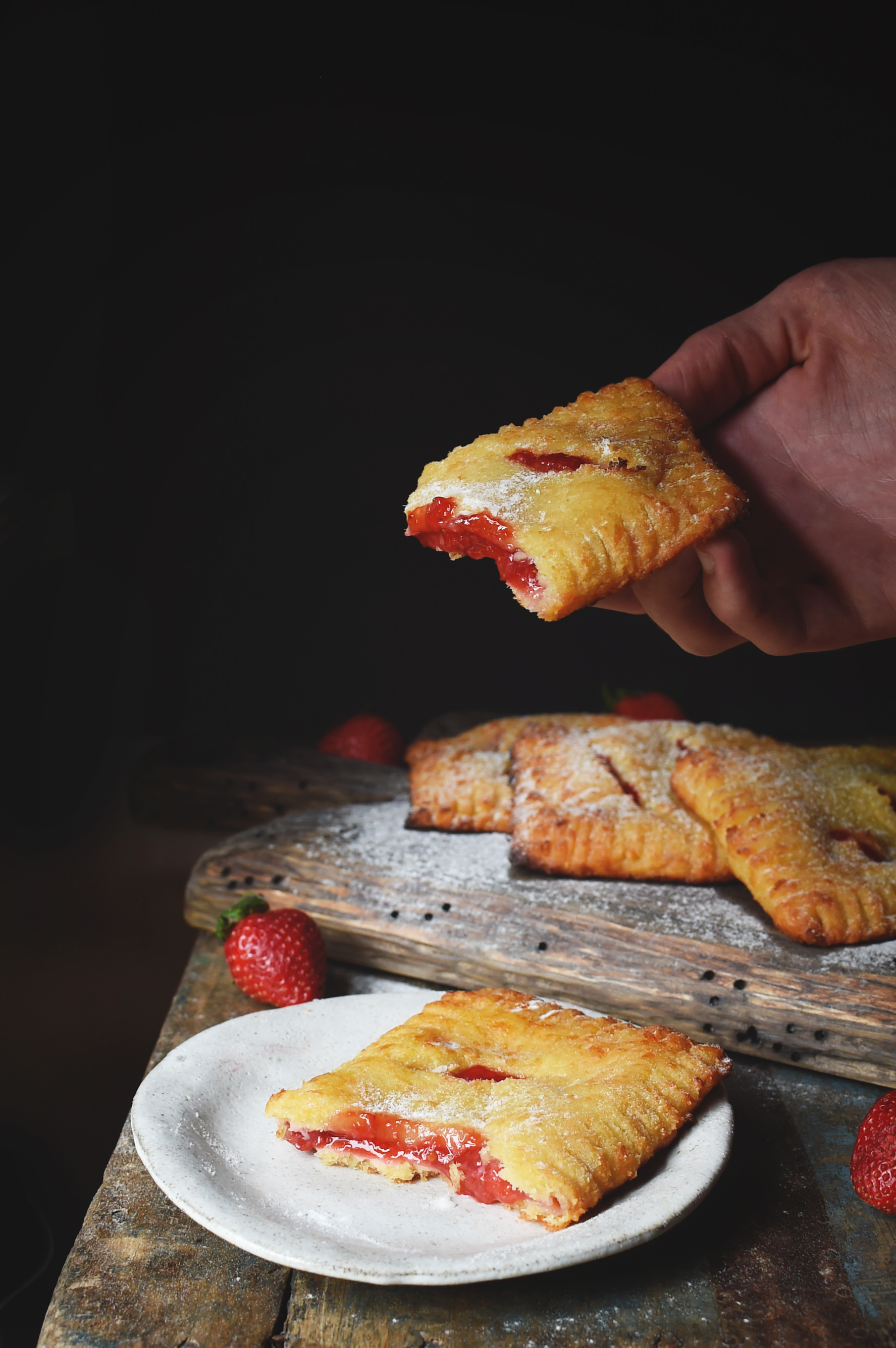 Low-Carb Strawberry Pastries Recipe-taking a bite.