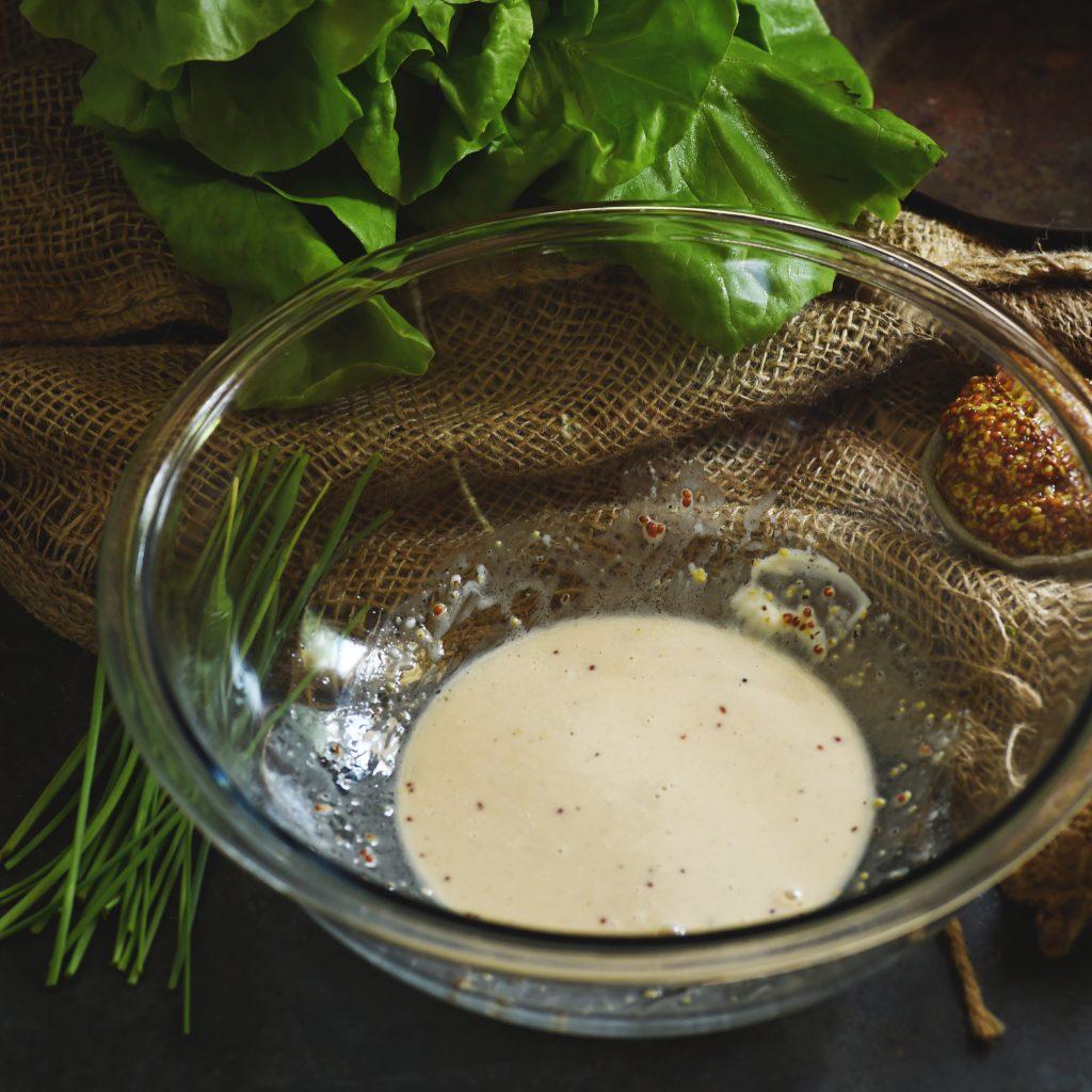 Low-Carb Bacon Vinaigrette Recipe-Whisking ingredients.