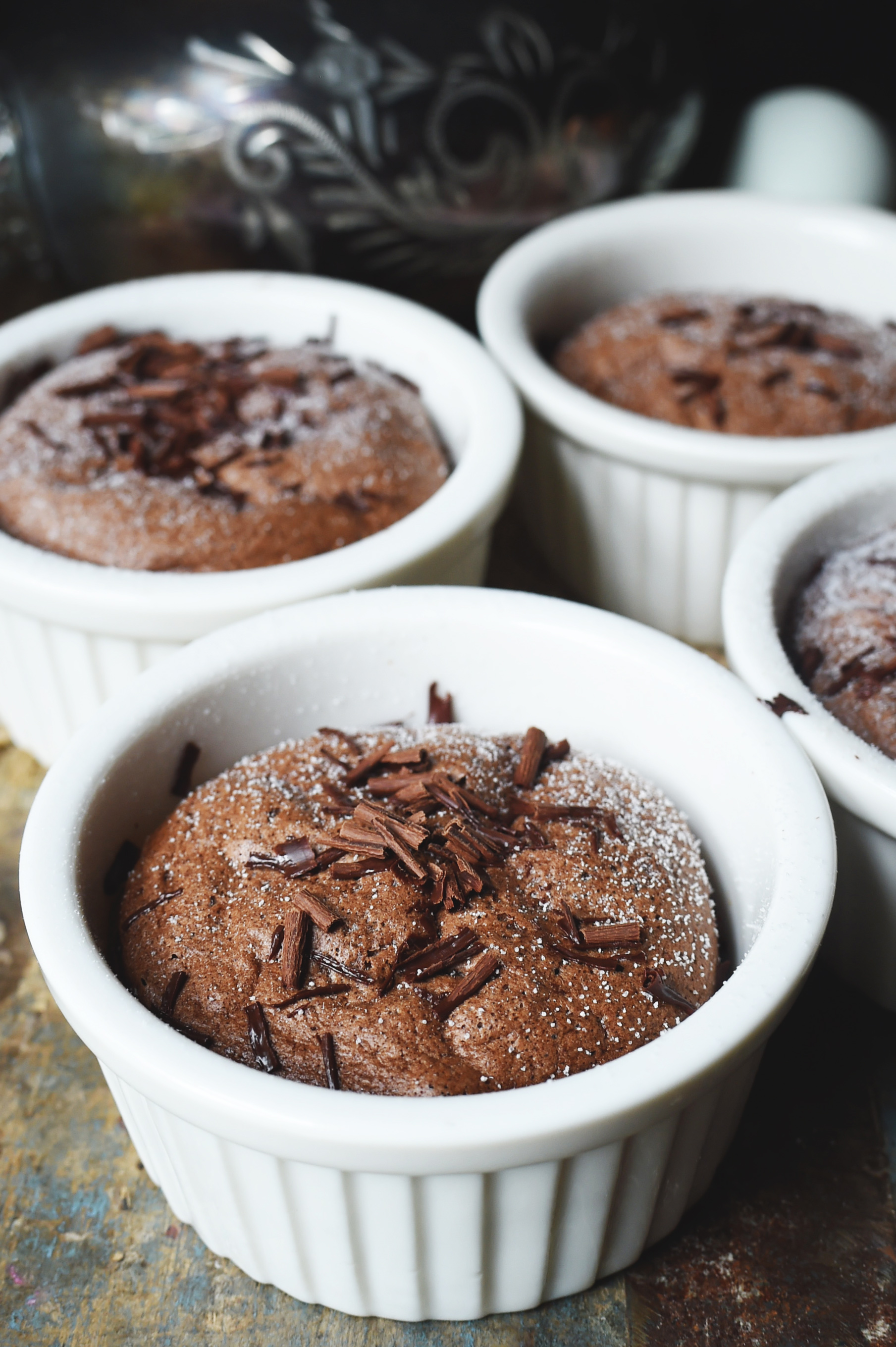 Low-Carb Chocolate Soufflé Recipe -with powdered sweetener and chocolate crumbles on top.