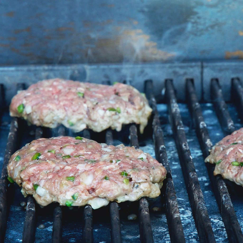 Low-Carb Easy Grilled Jalapeño Burgers-Placing the burgers on the grill.