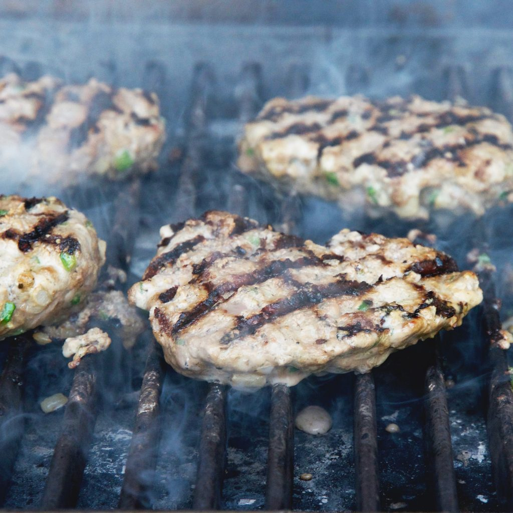 Low-Carb Easy Grilled Jalapeño Burgers-cooking the second side.