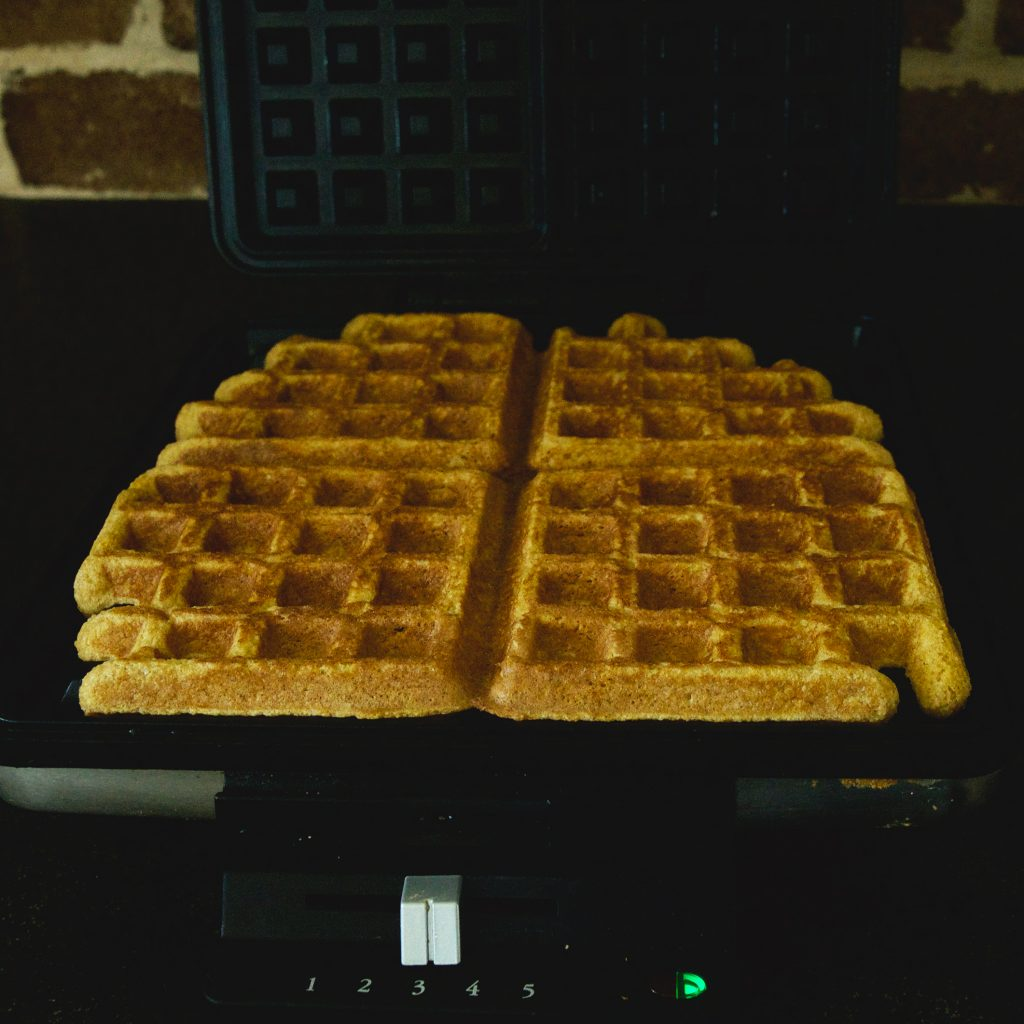Pumpkin Low-Carb Almond Flour Waffle Recipe -coming out of the waffle iron.