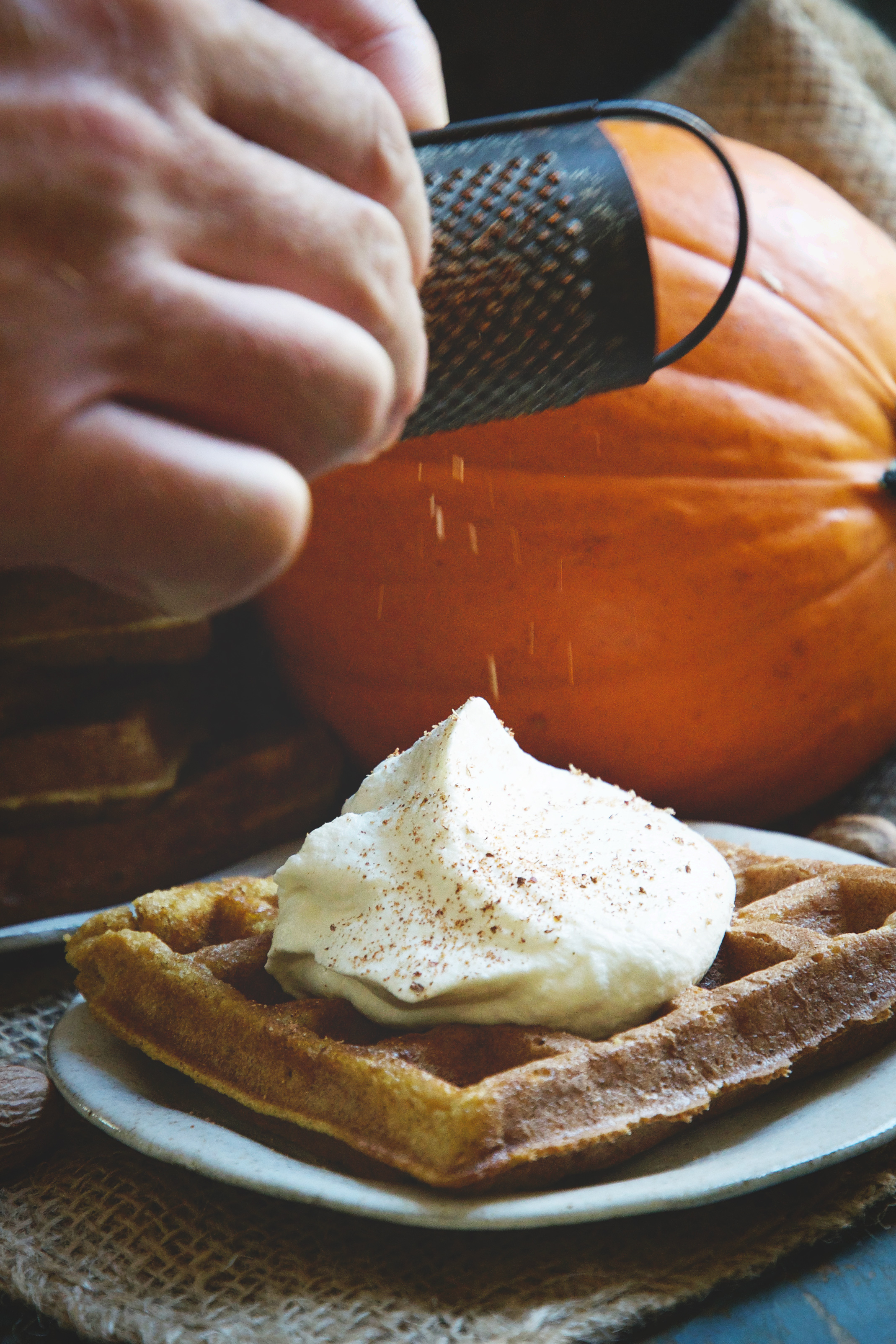 Pumpkin Low-Carb Almond Flour Waffle Recipe -grating on the nutmeg.