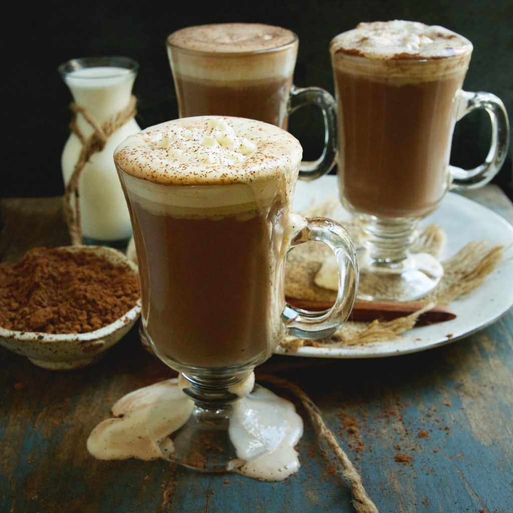 Keto-Friendly Sugar-Free Hot Chocolate Recipe -garnished with whipped cream and a dusting of cocoa