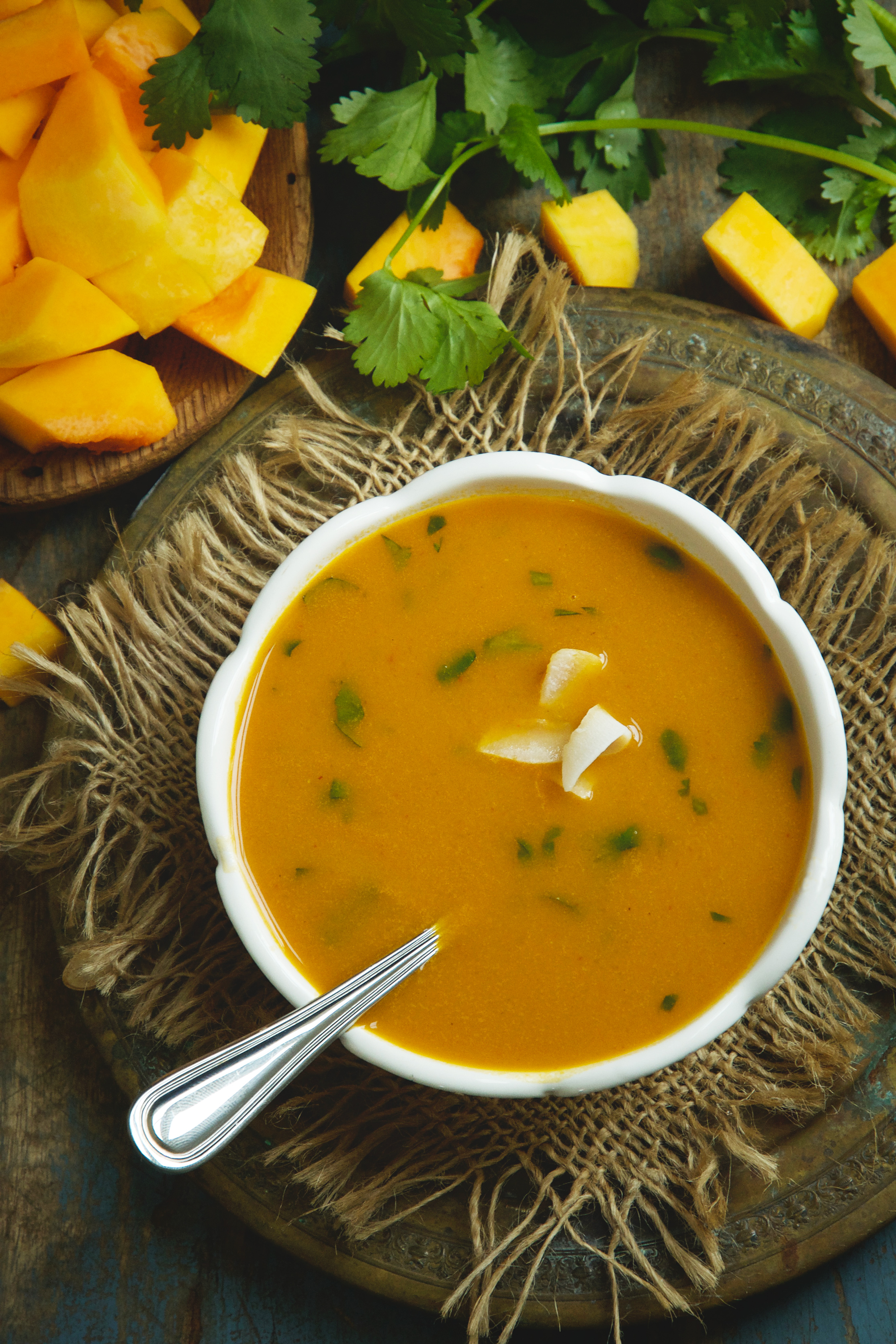 Low-Carb Thai Curried Butternut Squash Soup- with a spoon in the bowl.