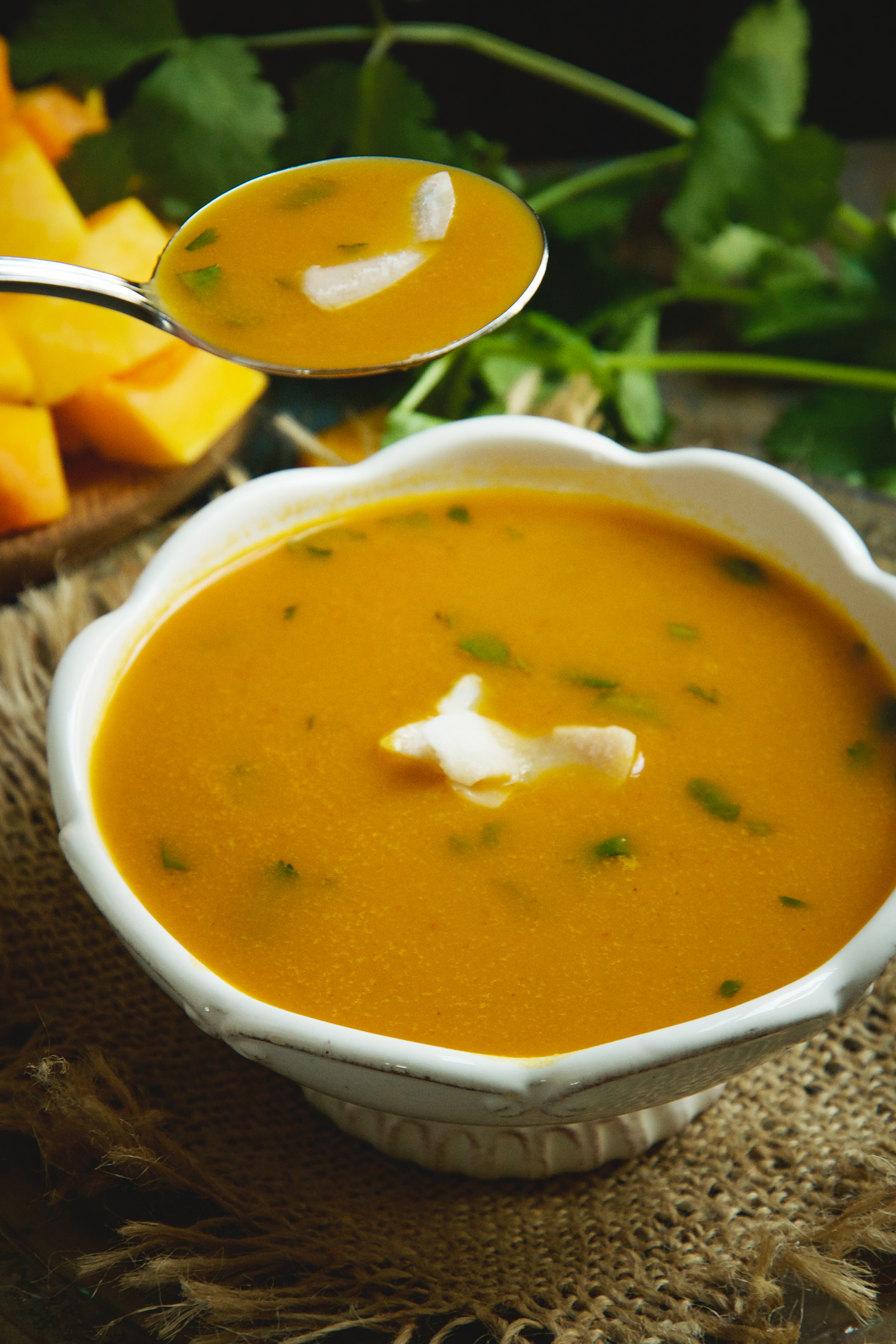 Low-Carb Thai Curried Butternut Squash Soup-spooning it out.