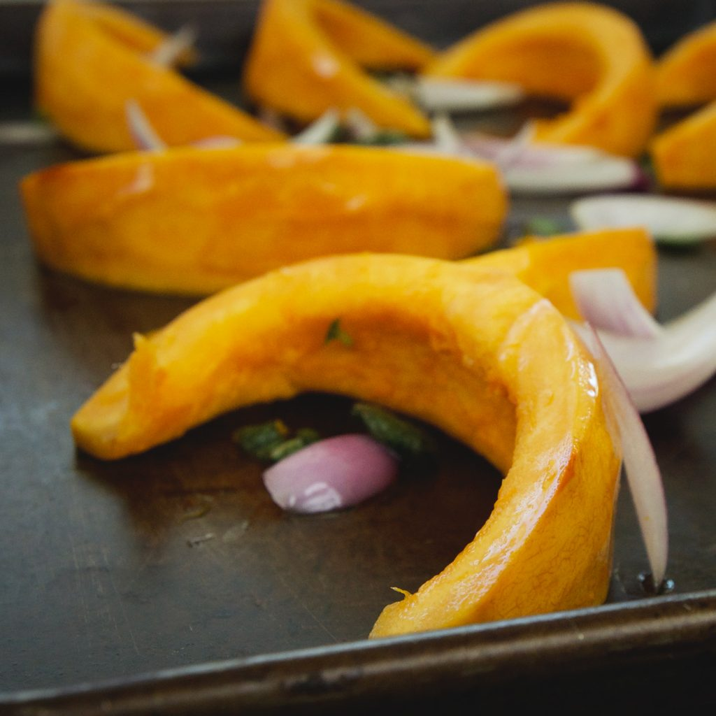 Low-Carb Roasted Pumpkin Salad -squash and onions on a plate.