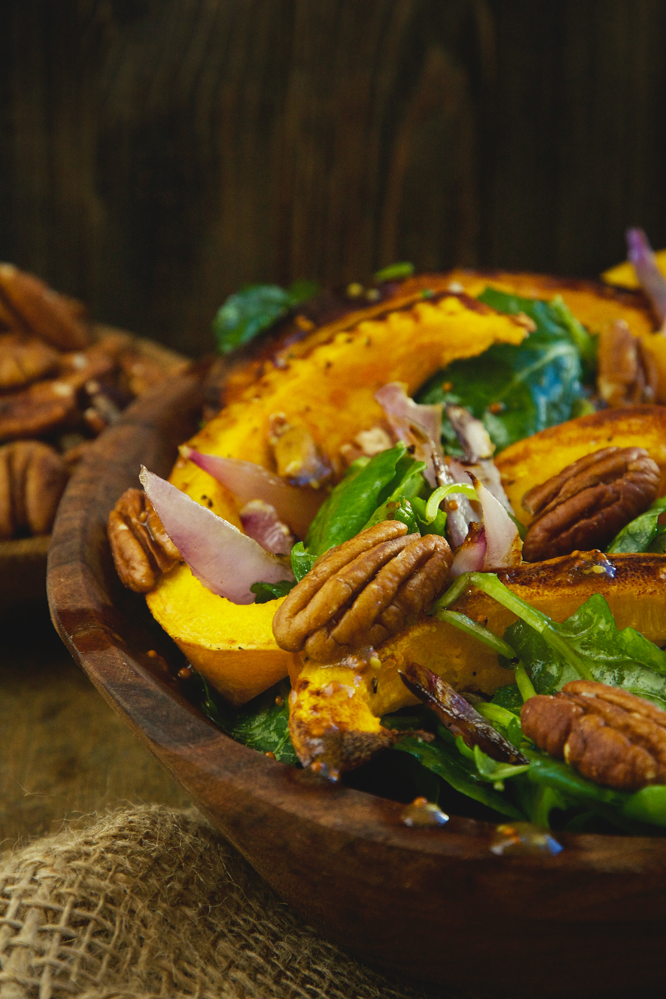 Low-Carb Roasted Pumpkin Salad - In a wooden bowl.