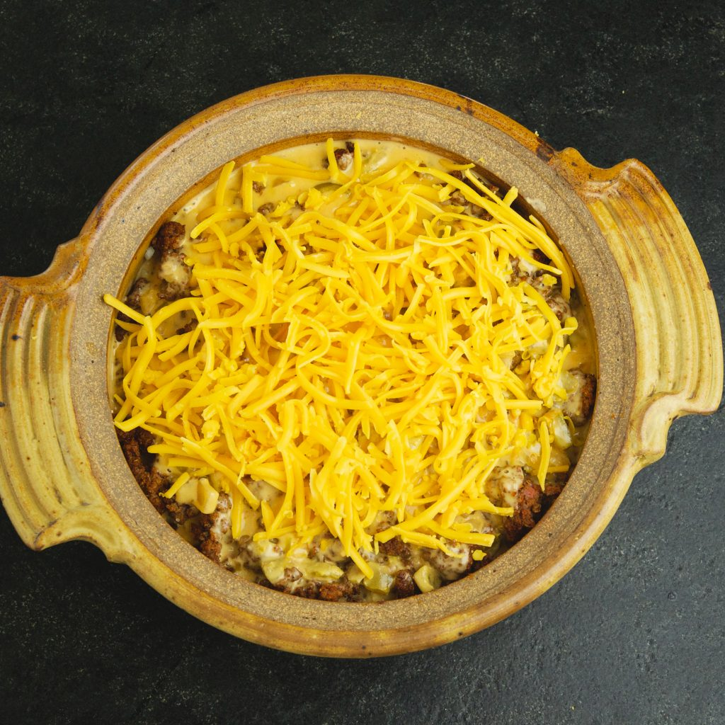 Low-Carb Mexican Taco Casserole-adding the top layer of cheese.