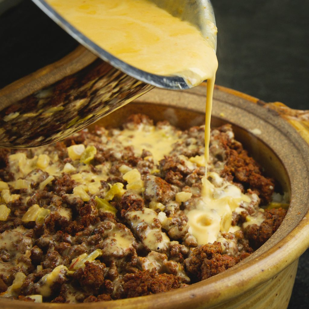 Low-Carb Mexican Taco Casserole-adding the cheese sauce.