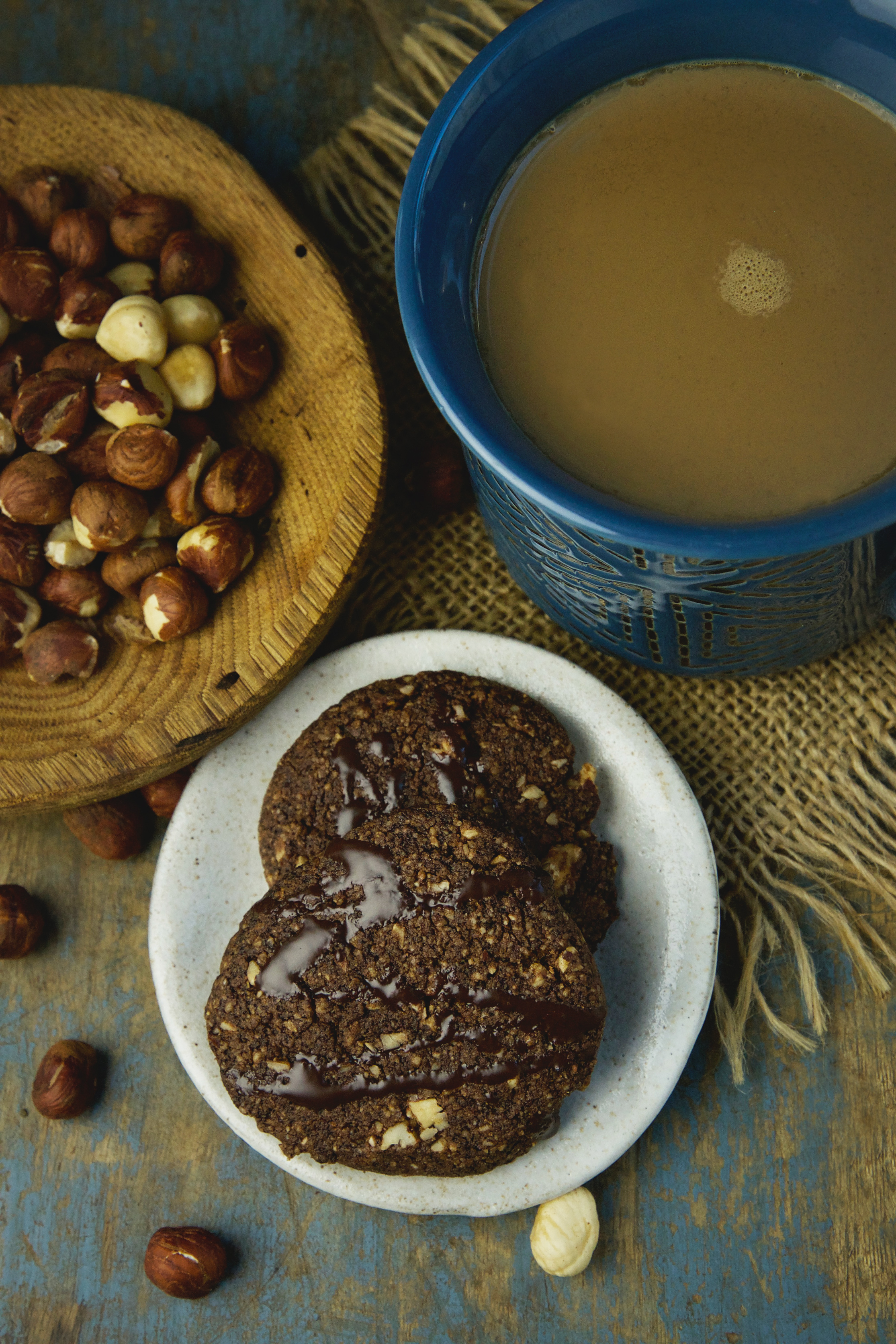 Low-Carb Chocolate Hazelnut Shortbread Cookies - served with a cup of coffee.