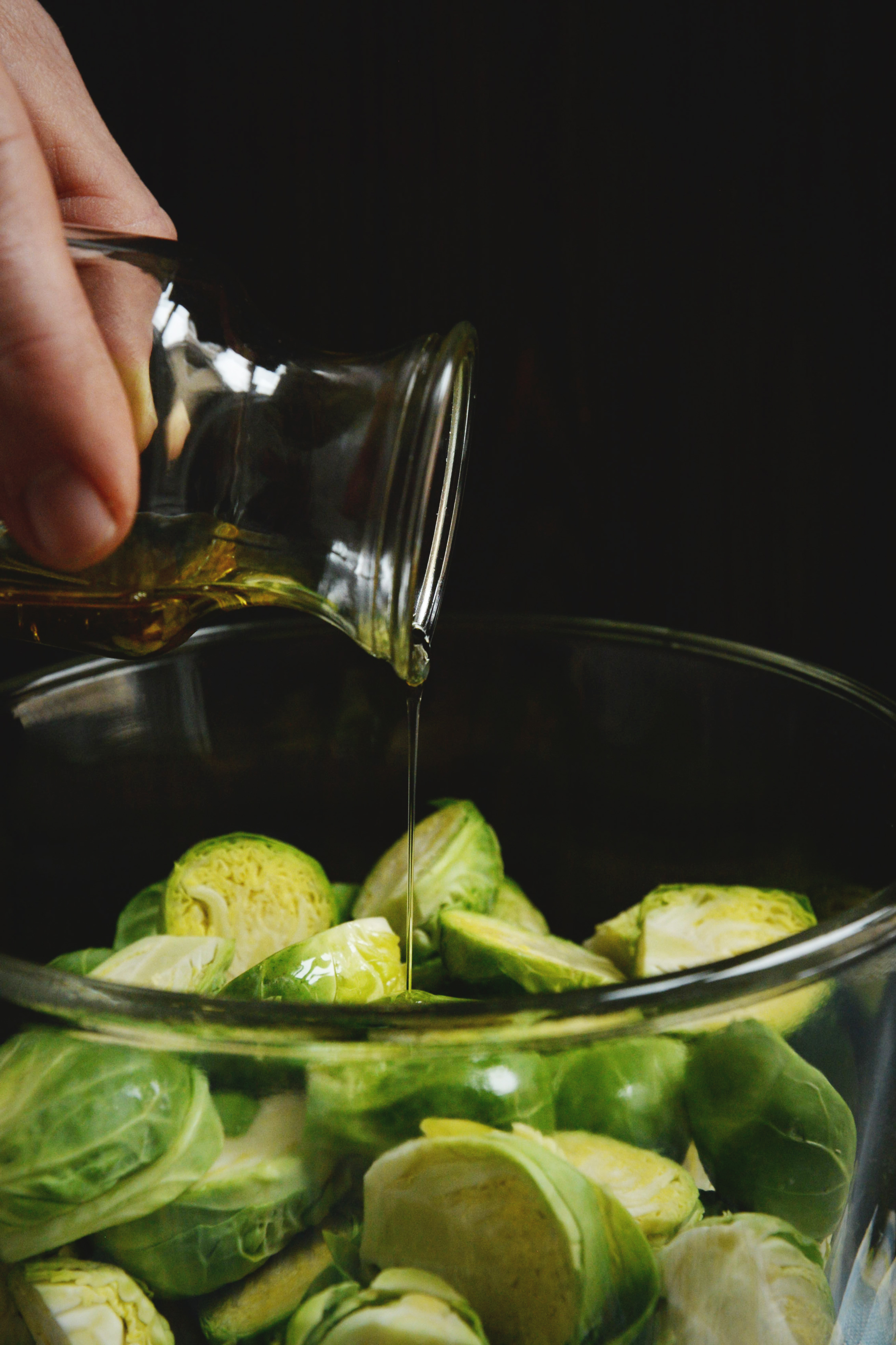 Easy Roasted Brussels Sprouts-drizzling with oil