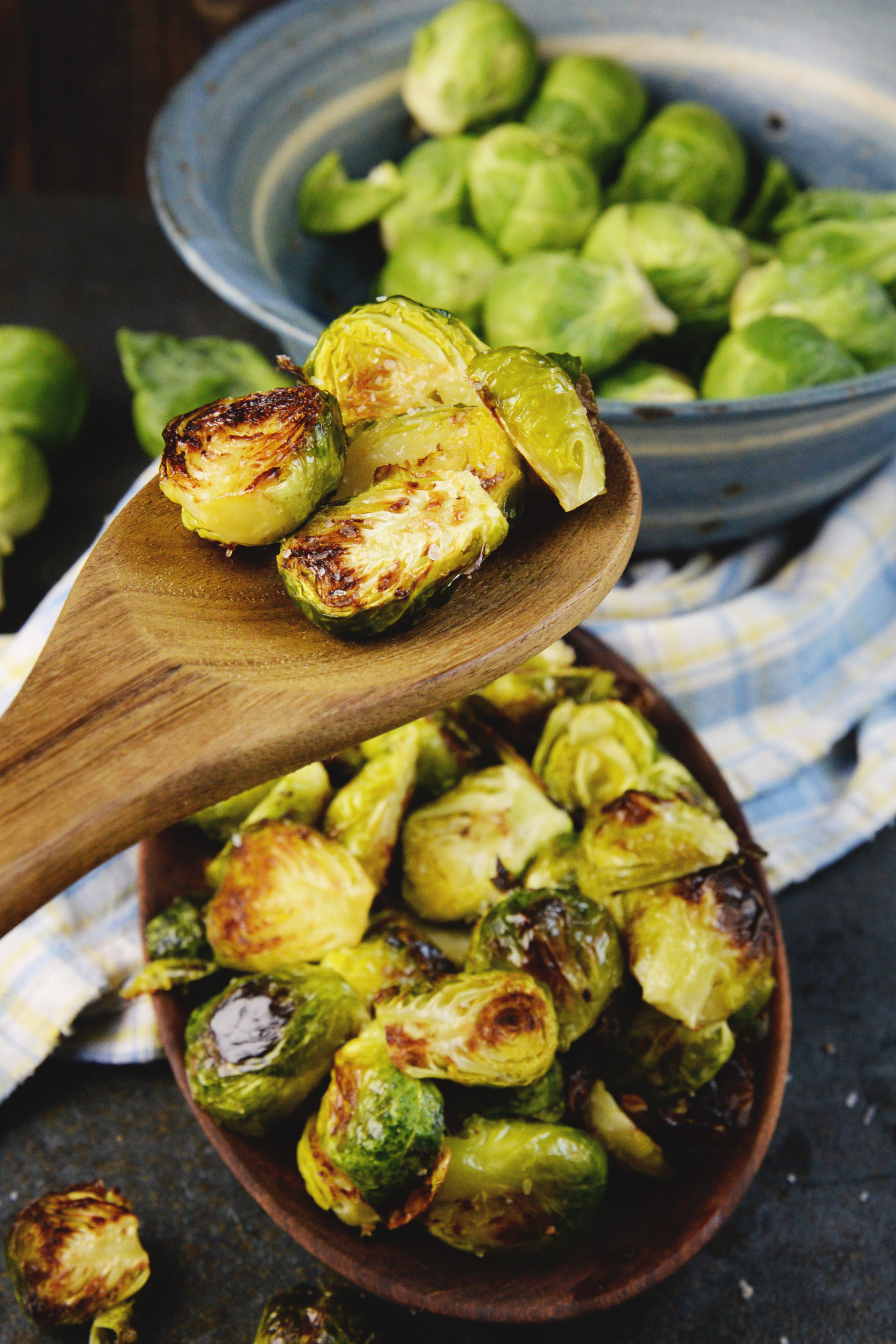 Easy Roasted Brussels Sprouts-on a wooden spoon