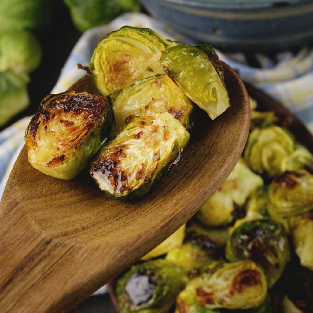 Easy Roasted Brussels Sprouts-on wooden spoon