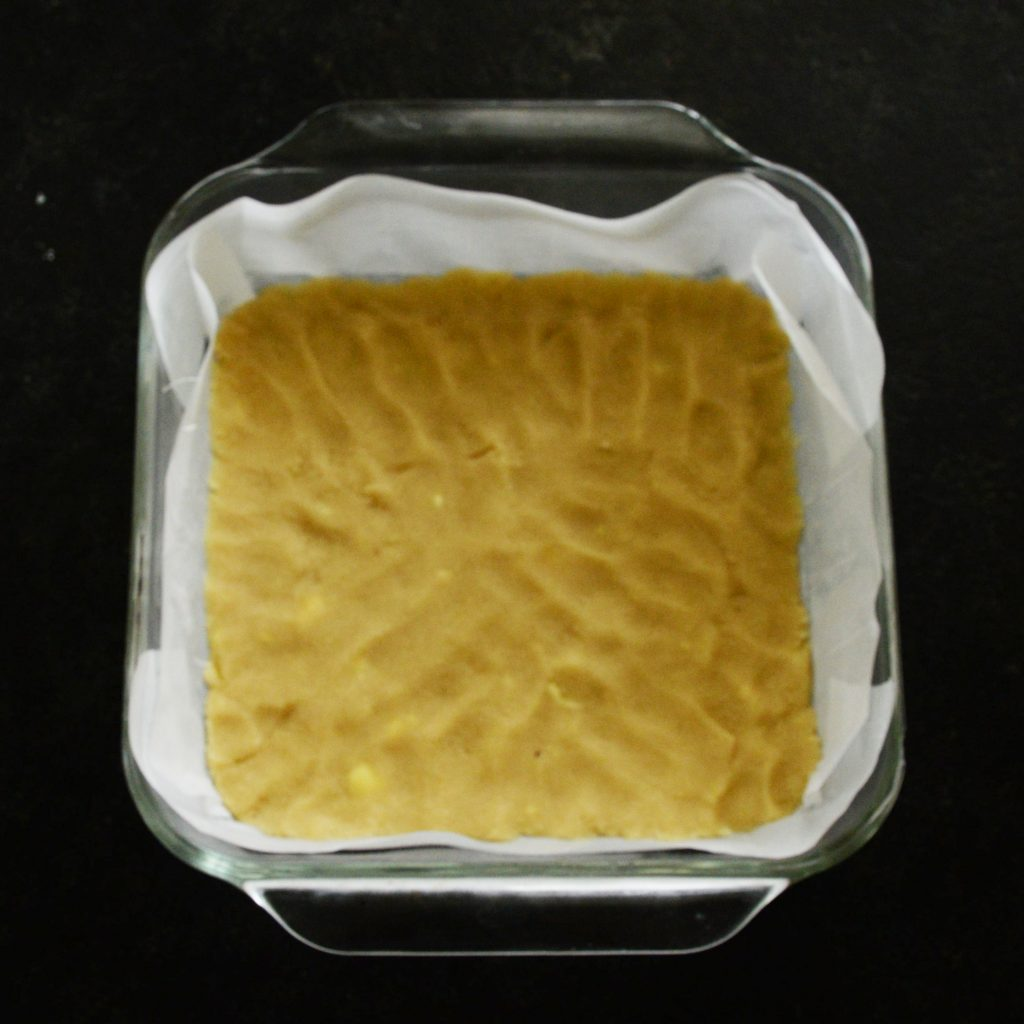 Low-Carb Coconut Lemon Bars--dough pressed into the prepared dish.