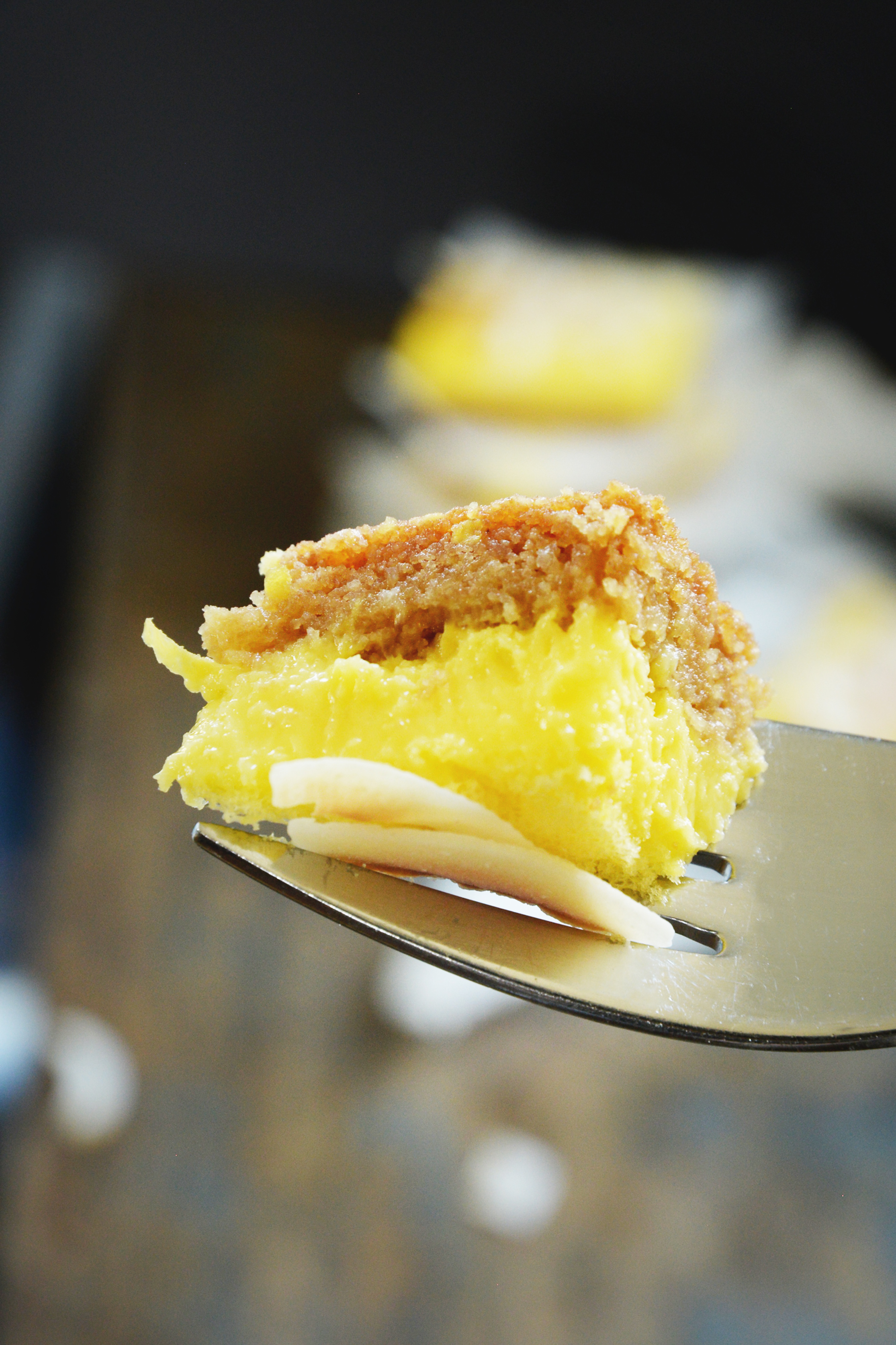 Low-Carb Coconut Lemon Bars--close-up of a bite.