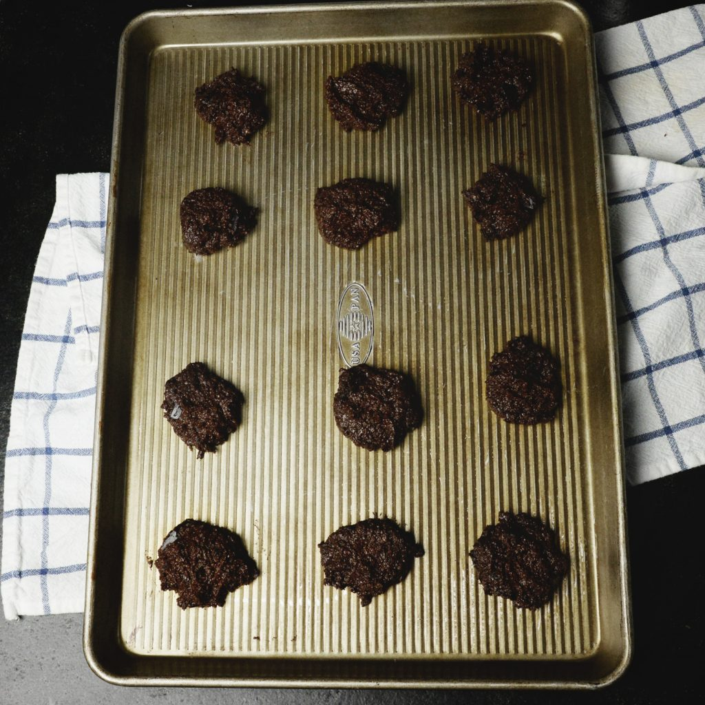 Keto-Friendly Double Chocolate Chip Cookies-Dough on a sheet.