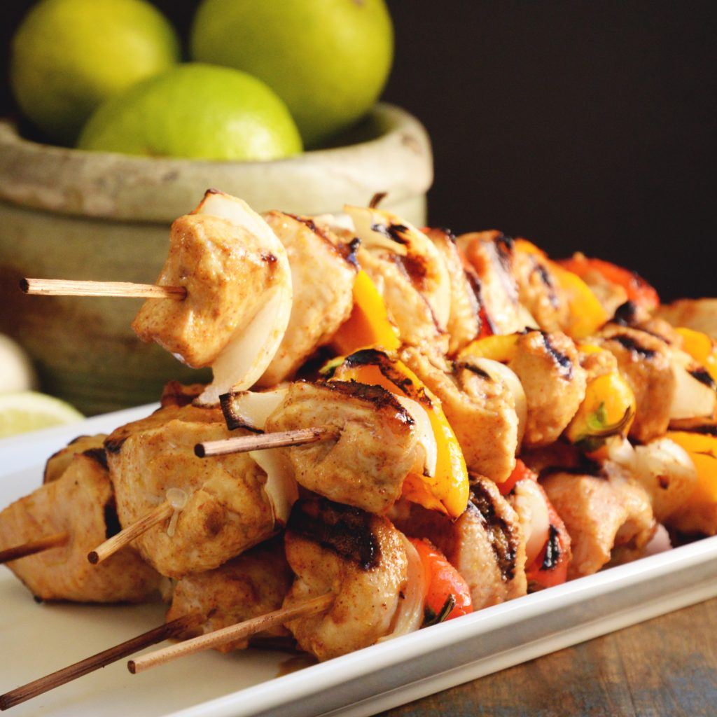 Grilled Fajita Chicken Kabobs-piled on a platter.